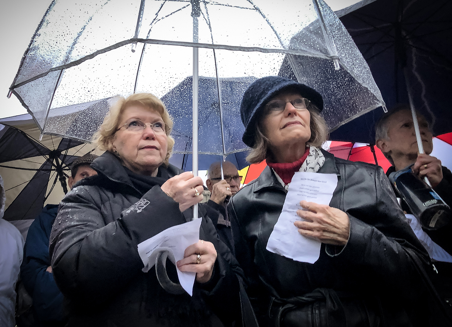 """Sonia Gerson, left, and Maggie Moscato, right, share an umbrella as they gather to listen to leaders from various faiths around Springfield deliver messages of support to the Jewish community as they mourn the loss of life at the Tree of Life Synagogue in Pittsburgh, Pa., during a vigil organized by the Jewish Federation of Springfield and the Jewish Community Relations Council on the steps of the Illinois State Capitol, Thursday, Nov. 1, 2018, in Springfield, Ill. """"My mother was a holocaust survivor and she escaped Germany in 1938,"""" said Gerson. """"The hatred has to stop, we've got to stop.""""  [Justin L. Fowler/The State Journal-Register]"""