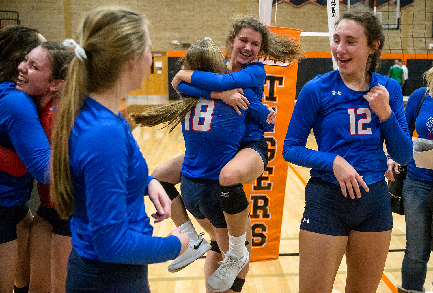 Pleasant Plains' Ali Fraase (7) celebrates with Pleasant Plains' Anna Kanllakan (18) after the Cardinals defeated Eureka in the Class 2A Beardstown Supersectional at Beardstown High School, Friday, Nov. 2, 2018, in Beardstown, Ill. [Justin L. Fowler/The State Journal-Register]