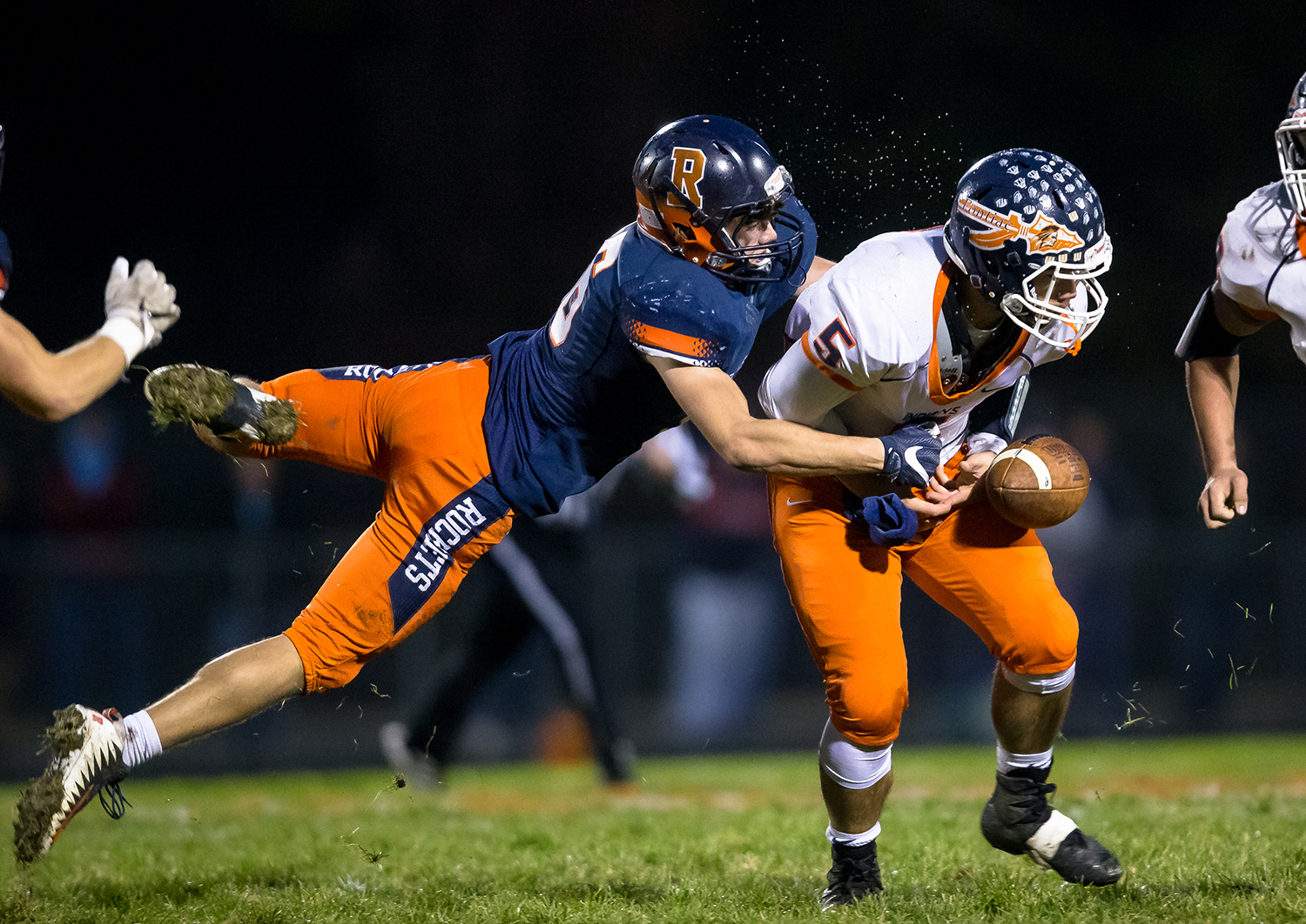 Rochester's Ethan Vose (86) forces a fumble from Pontiac quarterback Ben Schuler (5) in the first half in the second round of the Class 4A playoffs at Rochester High School, Saturday, Nov. 3, 2018, in Rochester, Ill. [Justin L. Fowler/The State Journal-Register]