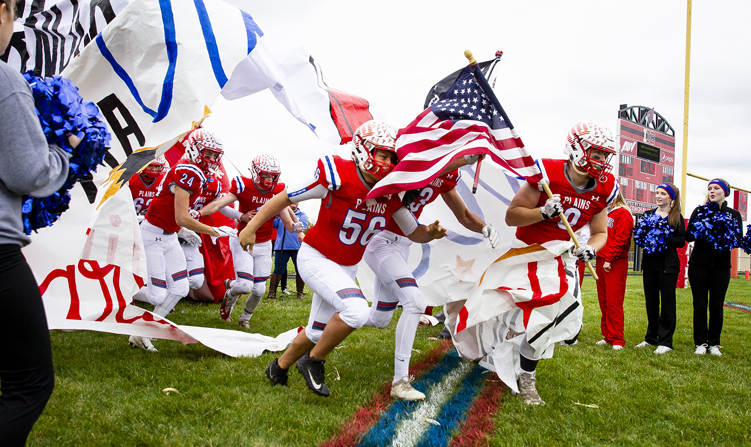 Pleasant Plains seniors Chris Ellis (56), Keigan Halford (3) and Jake Hermes lead the Cardinals onto the field for the Class 2A playoff game against the Greenville Comets Saturday, Nov. 3, 2018 at Pleasant Plains High School in Pleasant Plains, Ill. [Rich Saal/The State Journal-Register]