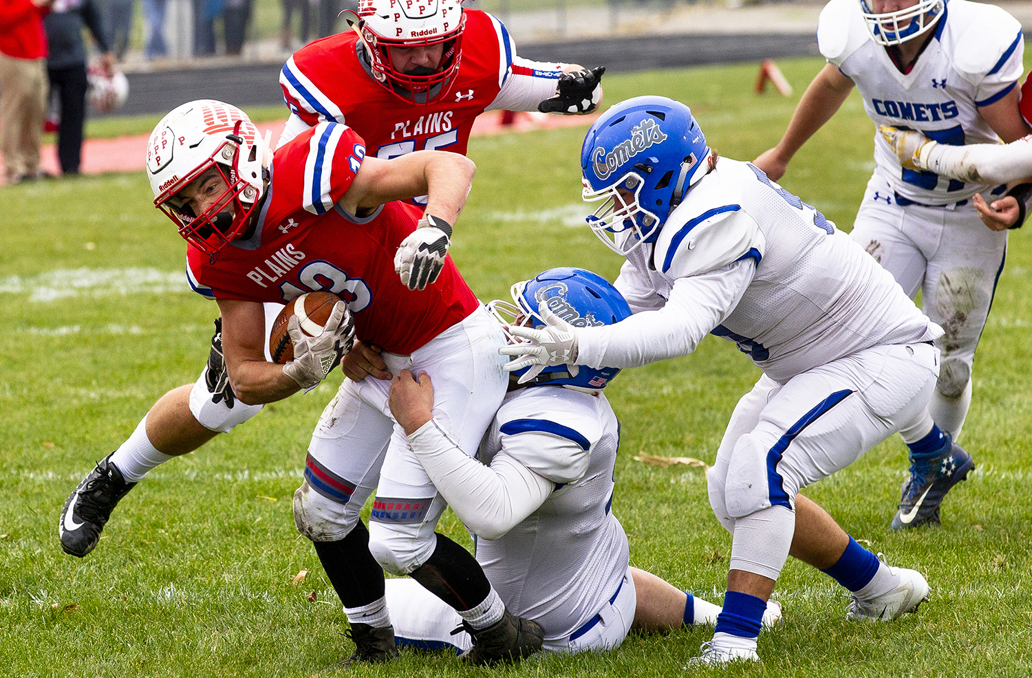 Pleasant Plains' Lucas Western cannot escape the grasp of Greenville's Harley Feaster in the Class 2A playoff game Saturday, Nov. 3, 2018 at Pleasant Plains High School in Pleasant Plains, Ill. Western was held to 86 yard rushing.[Rich Saal/The State Journal-Register]