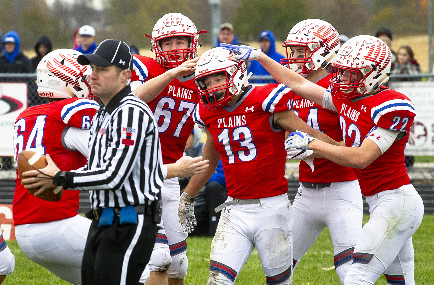Pleasant Plains' Lucas Western is congratulated by teammates after recovering a Greenville fumble and running it in for a touchdown to give the Cardinals' a 6-0 lead in the second quarter of the Class 2A playoff game Saturday, Nov. 3, 2018 at Pleasant Plains High School in Pleasant Plains, Ill. [Rich Saal/The State Journal-Register]