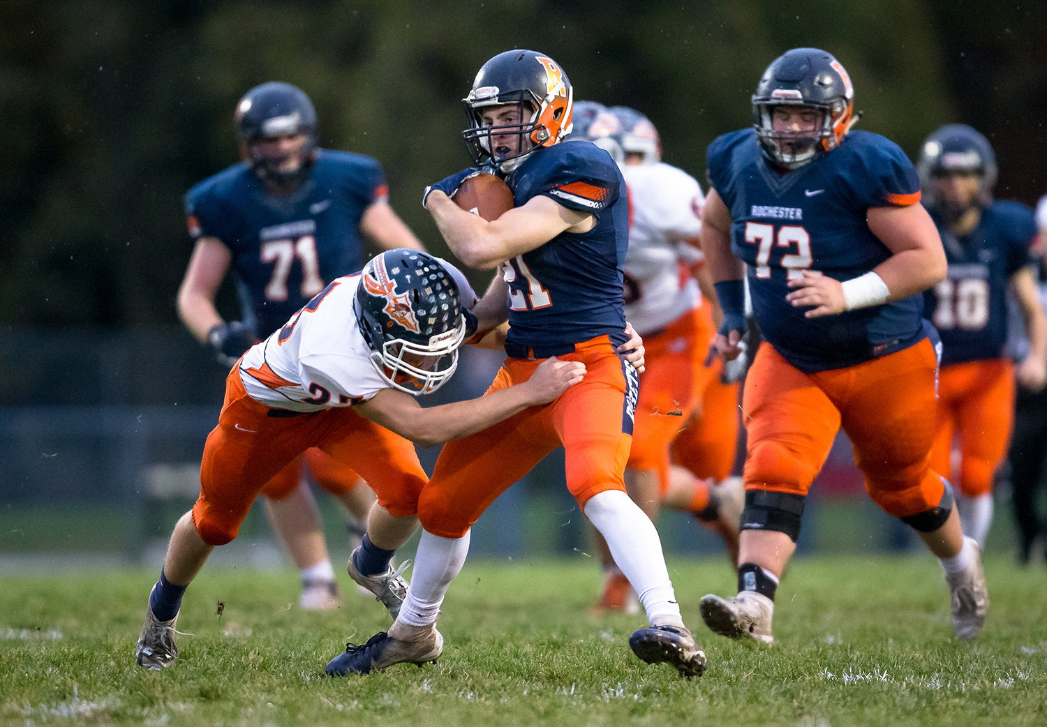 Rochester's David Yoggerst (21) tries to shed a tackle from Pontiac's Nic Hendron (23) on a rush in the first half in the second round of the Class 4A playoffs at Rochester High School, Saturday, Nov. 3, 2018, in Rochester, Ill. [Justin L. Fowler/The State Journal-Register]