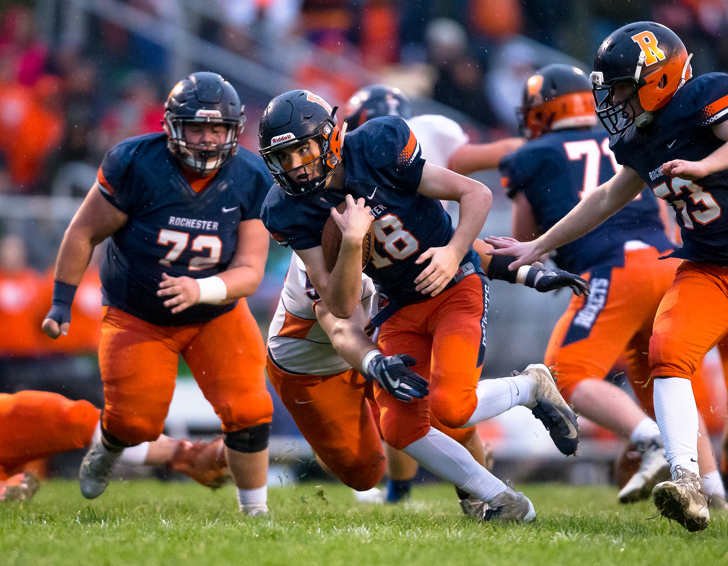 Rochester quarterback Clay Bruno (18) tucks the ball in as he takes off on a rush against Pontiac in the first half in the second round of the Class 4A playoffs at Rochester High School, Saturday, Nov. 3, 2018, in Rochester, Ill. [Justin L. Fowler/The State Journal-Register]