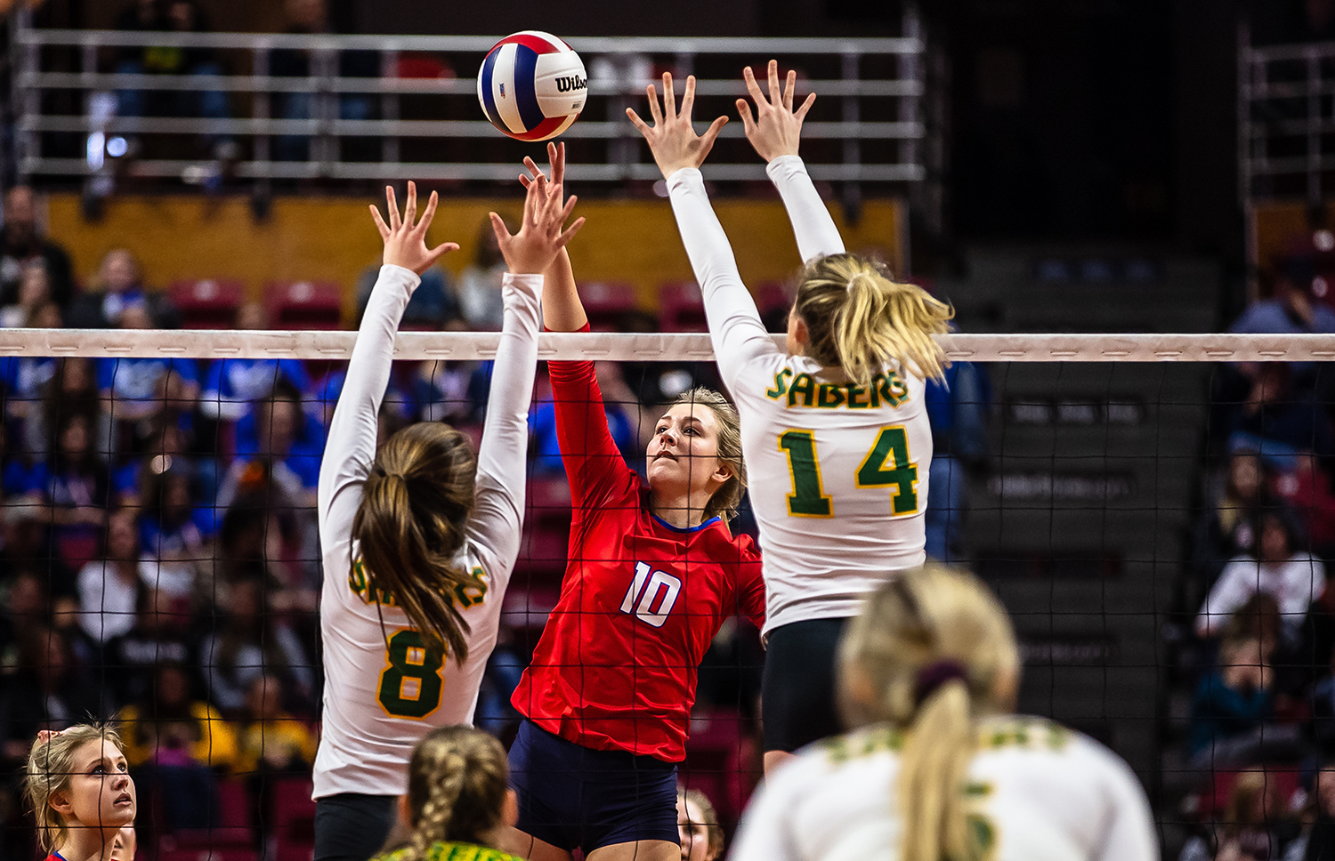 Pleasant Plains' Allie Edwards (10) sends an attack over the net against Champaign St. Thomas More's Maris Green (8) and Champaign St. Thomas More's Allie Trame (14)  during the Class 2A IHSA Volleyball State Final Tournament semifinals at Redbird Arena, Friday, Nov. 9, 2018, in Normal, Ill. [Justin L. Fowler/The State Journal-Register]