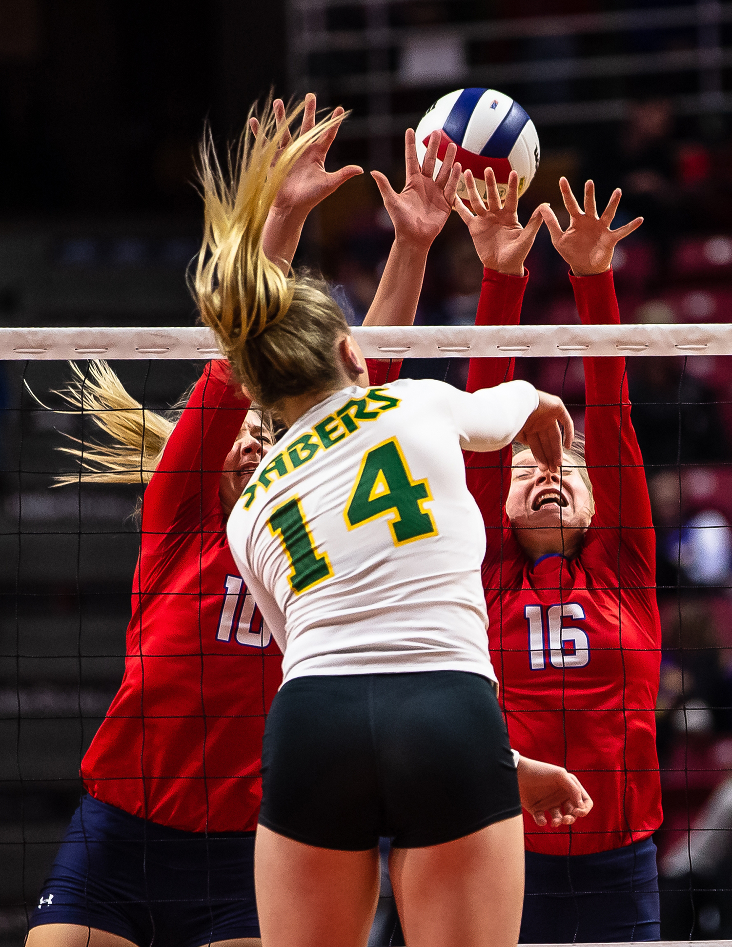 Champaign St. Thomas More's Allie Trame (14) sends a kill over Pleasant Plains' Allie Edwards (10) and Pleasant Plains' Macy Kanllakan (16) during the Class 2A IHSA Volleyball State Final Tournament semifinals at Redbird Arena, Friday, Nov. 9, 2018, in Normal, Ill. [Justin L. Fowler/The State Journal-Register]
