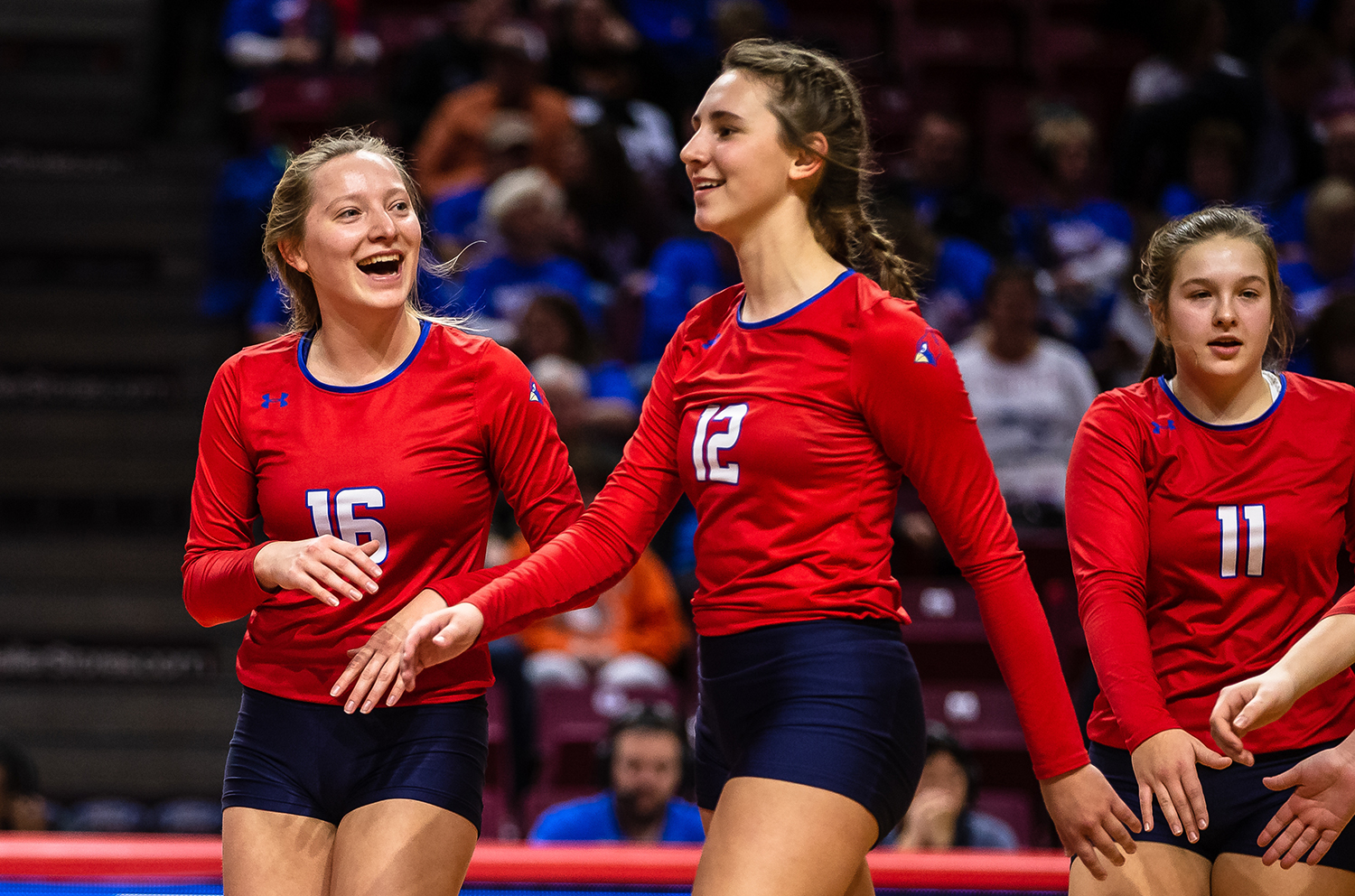 Pleasant Plains' Macy Kanllakan (16) and Pleasant Plains' Maddie Reiser (12) get fired up after a time out as the Cardinals take on Champaign St. Thomas More during the Class 2A IHSA Volleyball State Final Tournament semifinals at Redbird Arena, Friday, Nov. 9, 2018, in Normal, Ill. [Justin L. Fowler/The State Journal-Register]
