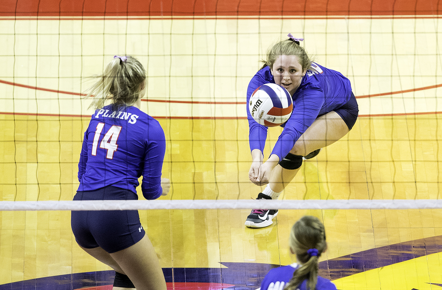 Pleasant Plains' McKenzie Smith digs a ball against Galena during the IHSA Class 2A Volleyball championship at Redbird Arena in Normal Saturday, Nov. 10, 2018. [Ted Schurter/The State Journal-Register]