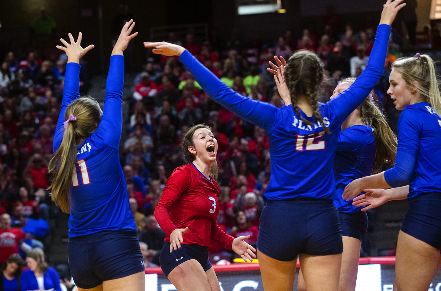 Pleasant Plains' MacKenzie Houser and the Cardinals celebrate a point against Galena during the IHSA Class 2A Volleyball championship at Redbird Arena in Normal Saturday, Nov. 10, 2018. [Ted Schurter/The State Journal-Register]