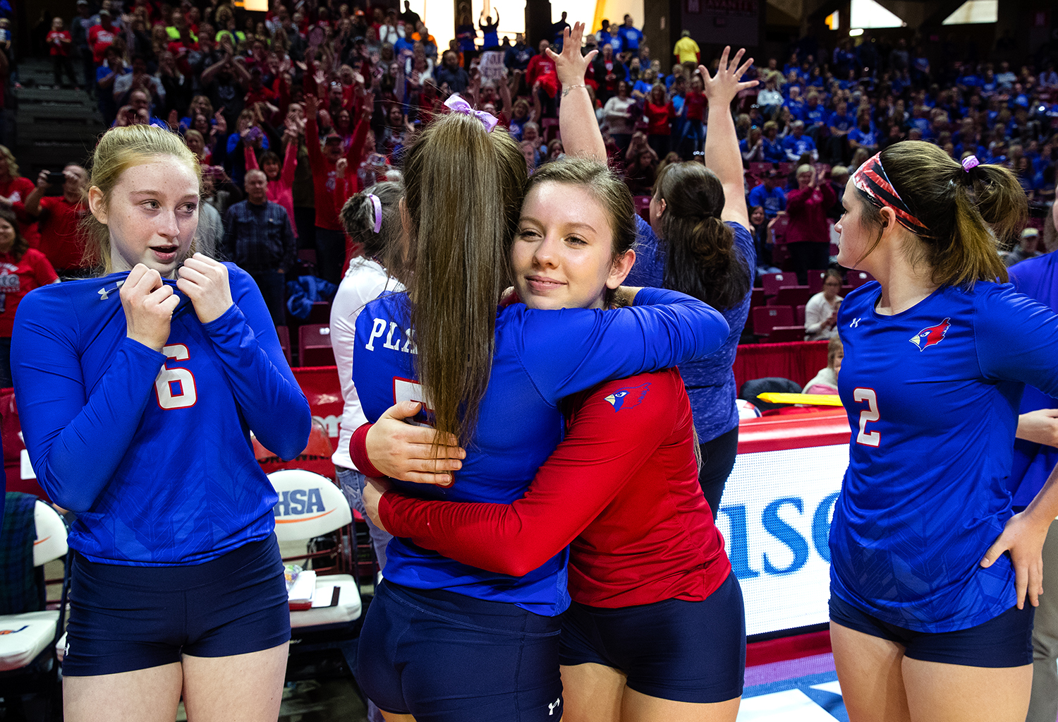 Pleasant Plains' MacKenzie Houser hugs Emma Grieser after the Cardinals defeated Galena during the IHSA Class 2A Volleyball championship at Redbird Arena in Normal Saturday, Nov. 10, 2018. [Ted Schurter/The State Journal-Register]