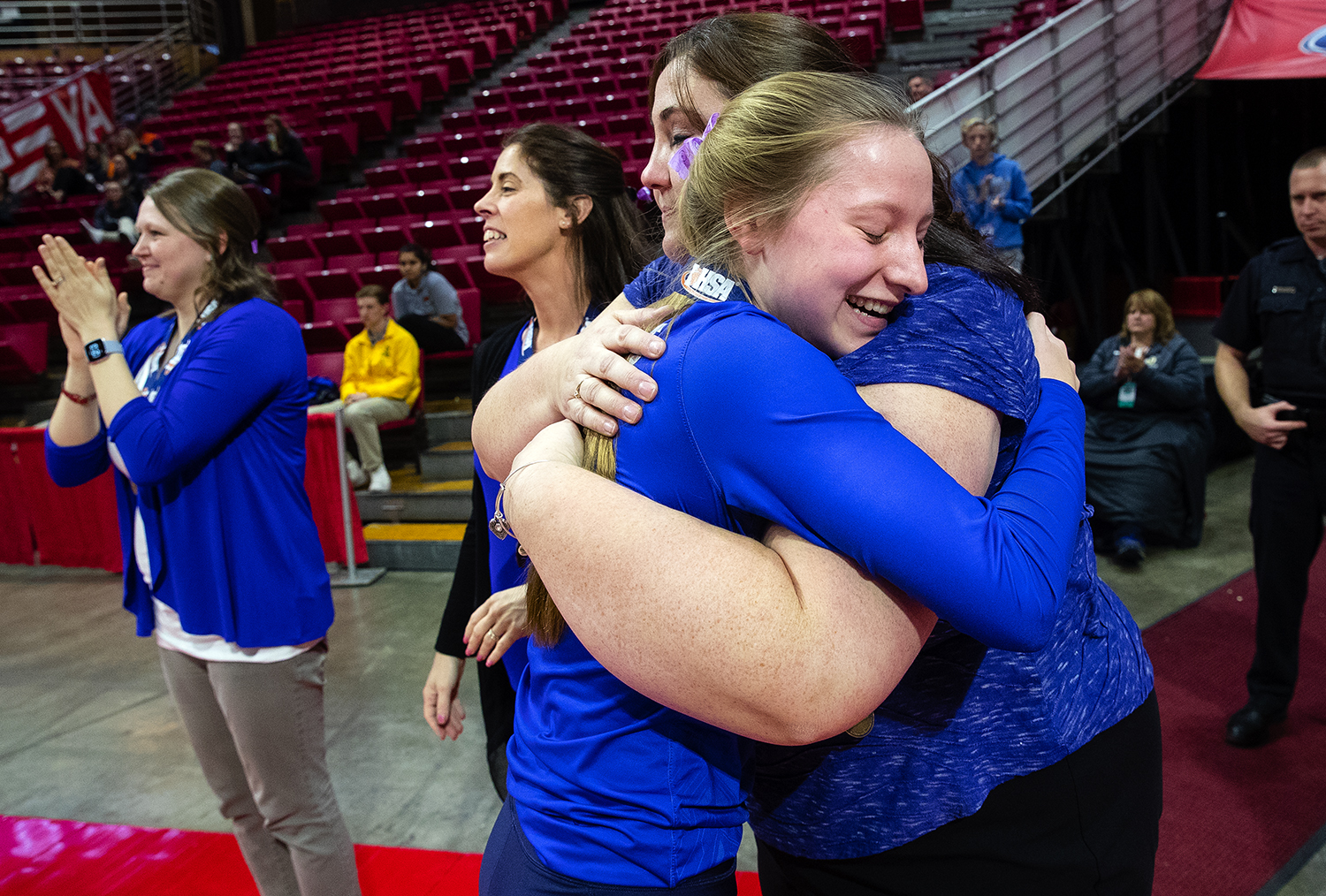 Pleasant Plains' Denise Dufour embraces Macy Kanllakan after the Cardinals defeated Galena during the IHSA Class 2A Volleyball championship at Redbird Arena in Normal Saturday, Nov. 10, 2018. [Ted Schurter/The State Journal-Register]
