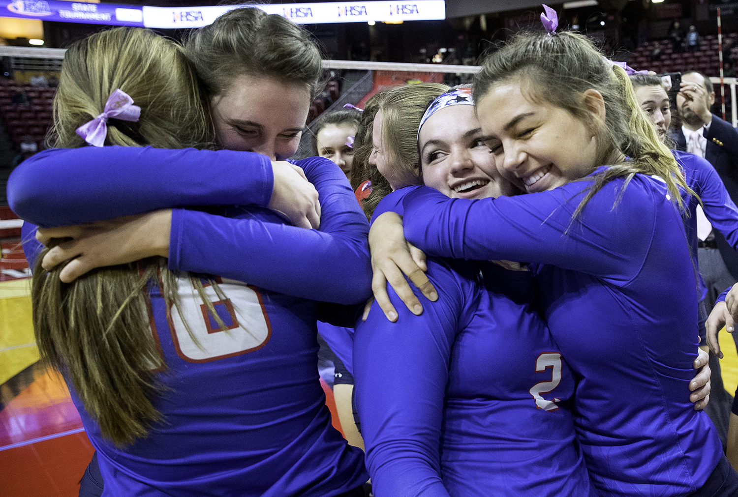 Pleasant Plains' Maddie Reiser  hugs Macy Kanllakan  as Emma Grieser  hugs Jade Garrett as the Cardinals celebrate their win against Galena during the IHSA Class 2A Volleyball championship at Redbird Arena in Normal Saturday, Nov. 10, 2018. [Ted Schurter/The State Journal-Register]