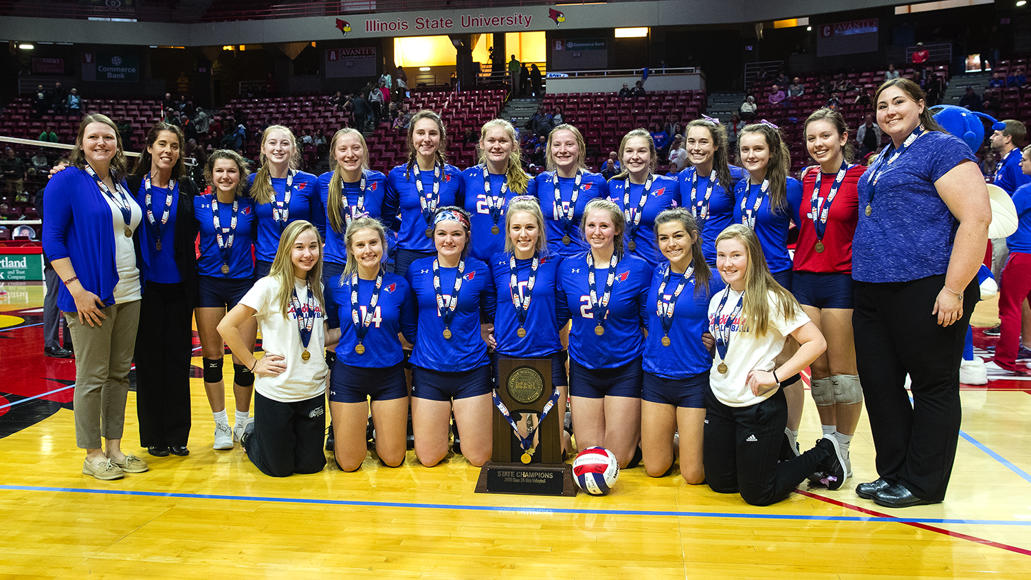 The Pleasant Plains Cardinals pose with their championship trophy after beating Galena in the IHSA Class 2A Volleyball championship at Redbird Arena in Normal Saturday, Nov. 10, 2018. [Ted Schurter/The State Journal-Register]