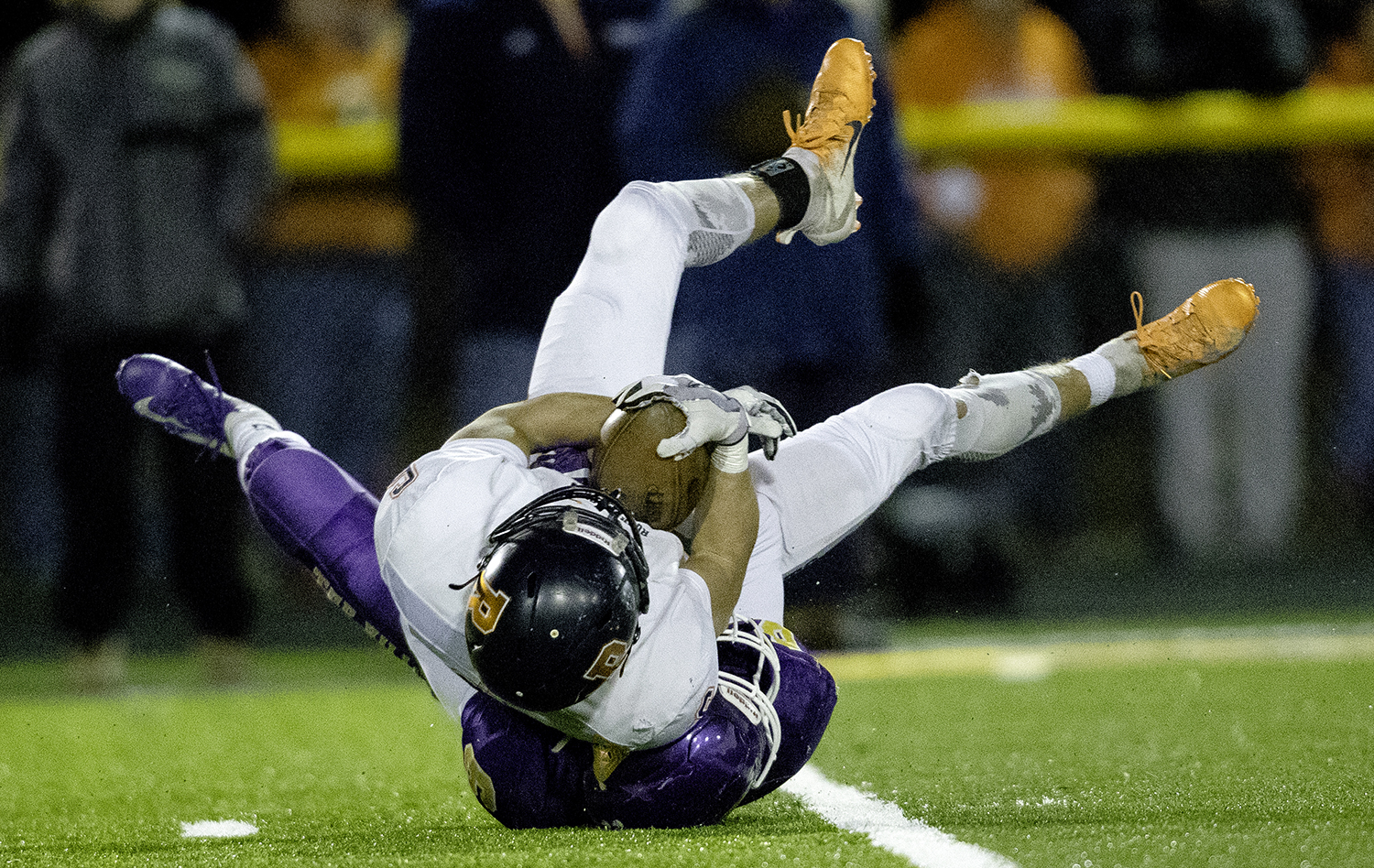 Taylorville's Kyle Durbin brings down Rochester's Cade Eddington in the first half during the Class 4A quarterfinals in Taylorville Saturday, Nov. 10, 2018. [Ted Schurter/The State Journal-Register]