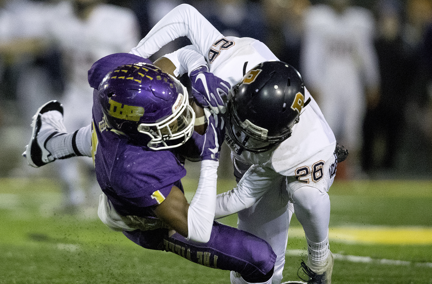 Taylorville's Yemi Obdugbesan makes a catch in front of Rochester's Jack Bruso during the Class 4A quarterfinals in Taylorville Saturday, Nov. 10, 2018. [Ted Schurter/The State Journal-Register]