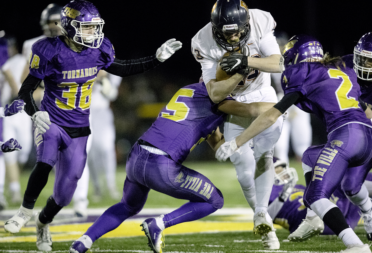 Rochester's Jacob DuRocher plows into the Taylorville defense during the Class 4A quarterfinals in Taylorville Saturday, Nov. 10, 2018. [Ted Schurter/The State Journal-Register]
