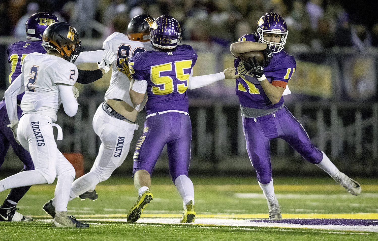 Taylorville's Brandon Odam tries to slip away from the Rochester defense during the Class 4A quarterfinals in Taylorville Saturday, Nov. 10, 2018. [Ted Schurter/The State Journal-Register]