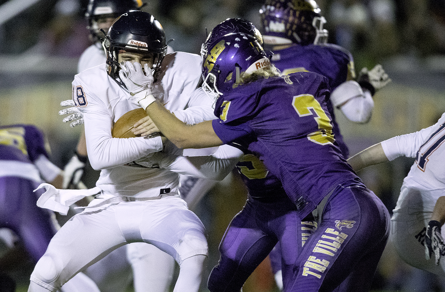 Taylorville's Will Kettelkamp grabs the facemask of Rochester's Clay Bruno as he rushes for the endzone during the Class 4A quarterfinals in Taylorville Saturday, Nov. 10, 2018. [Ted Schurter/The State Journal-Register]