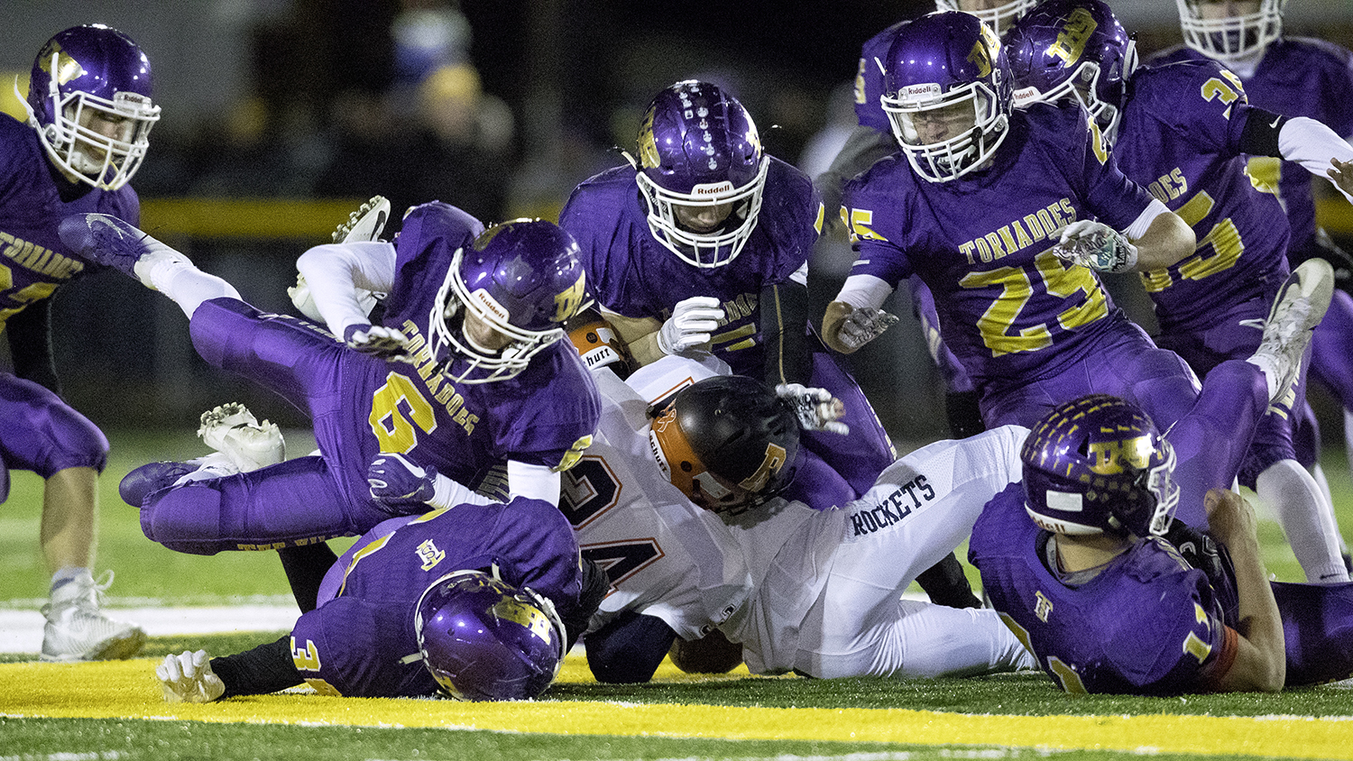 The Taylorville defense collapses onto an onside kick during the Class 4A quarterfinals in Taylorville Saturday, Nov. 10, 2018. [Ted Schurter/The State Journal-Register]