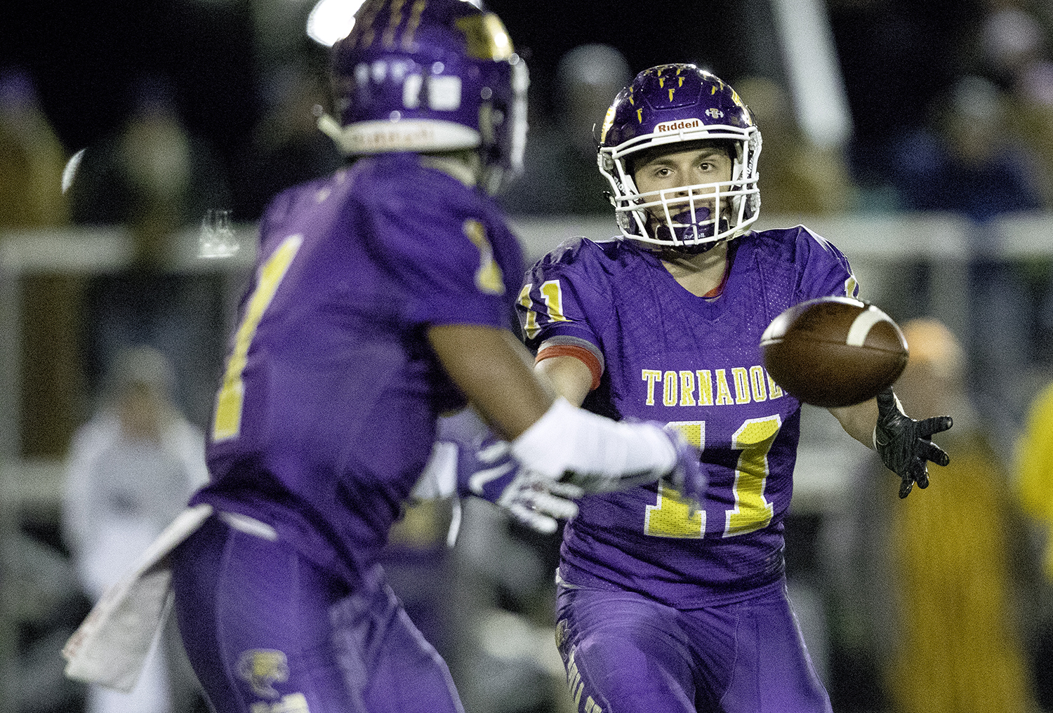 Taylorville's Brandon Odam tosses the ball to Taylorville's Yemi Obdugbesan during the Class 4A quarterfinals in Taylorville Saturday, Nov. 10, 2018. [Ted Schurter/The State Journal-Register]