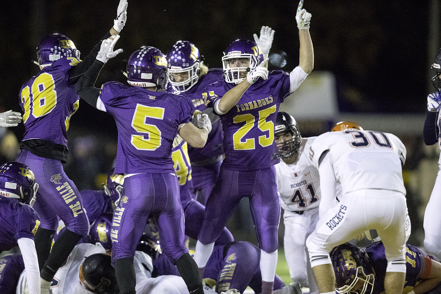Taylorville's Austin Herkert celebrates as Taylorville takes possession after an onside kick during the Class 4A quarterfinals in Taylorville Saturday, Nov. 10, 2018. [Ted Schurter/The State Journal-Register]