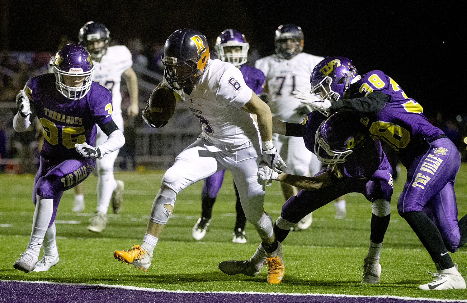 Rochester's Cade Eddington beats a trio of Taylorville defenders to the endzone during the Class 4A quarterfinals in Taylorville Saturday, Nov. 10, 2018. [Ted Schurter/The State Journal-Register]