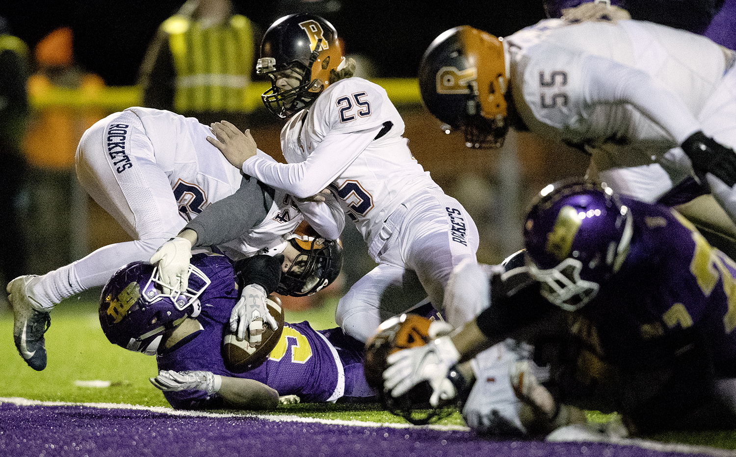 Rochester defenders stop Taylorville's Riley Buschon short of the endzone during the Class 4A quarterfinals in Taylorville Saturday, Nov. 10, 2018. [Ted Schurter/The State Journal-Register]