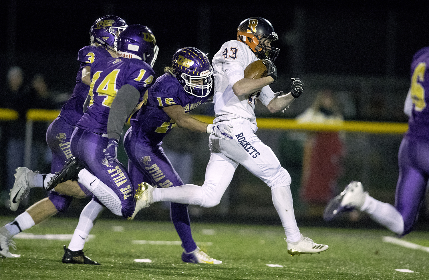 Rochester's Jacob DuRocher sprints ahead of the Taylorville defense during the Class 4A quarterfinals in Taylorville Saturday, Nov. 10, 2018. [Ted Schurter/The State Journal-Register]