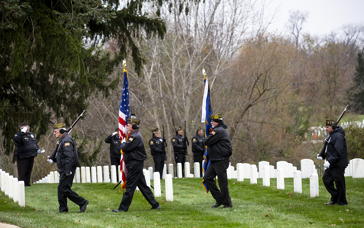 The Inter-Veterans Burial Detail of Sangamon County Color Guard closes out the Veterans Day ceremony at Camp Butler National Cemetery Monday, Nov. 12, 2018 in Springfield, Ill. [Rich Saal/The State Journal-Register]