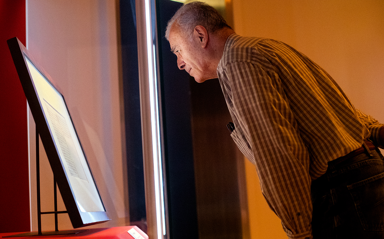 Frank Cordoba of San Diego, CA, gazes at a handwritten copy of the Gettysburg Address on display at the Abraham Lincoln Presidential Museum Friday, Nov. 16, 2018. The document is one of many copies Lincoln gave out after the speech in November 1863. One was given to a group that sold it to raise money for the benefit of wounded soldiers. Four score years later, it was for sale again and Illinois schoolchildren donated pennies and nickels so the state could buy the document. That copy is the one now housed at the presidential library and will be on display through Nov 25. [Ted Schurter/The State Journal-Register]