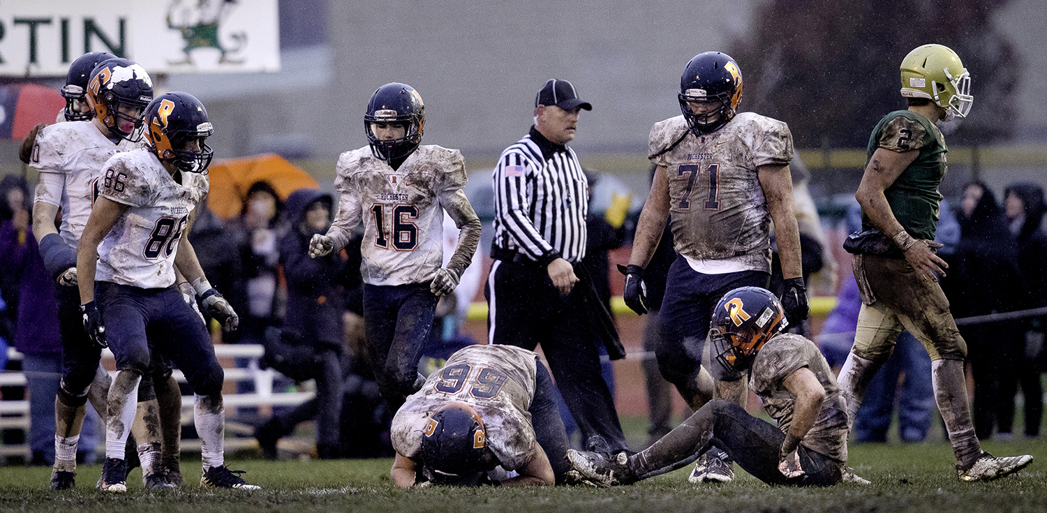 Rochester's Connor Sweeney puts his head down after Bishop McNamara extra point attempt during the Class 4A semifinal at Kankakee Bishop McNamara Saturday, Nov. 17, 2018. [Ted Schurter/The State Journal-Register]
