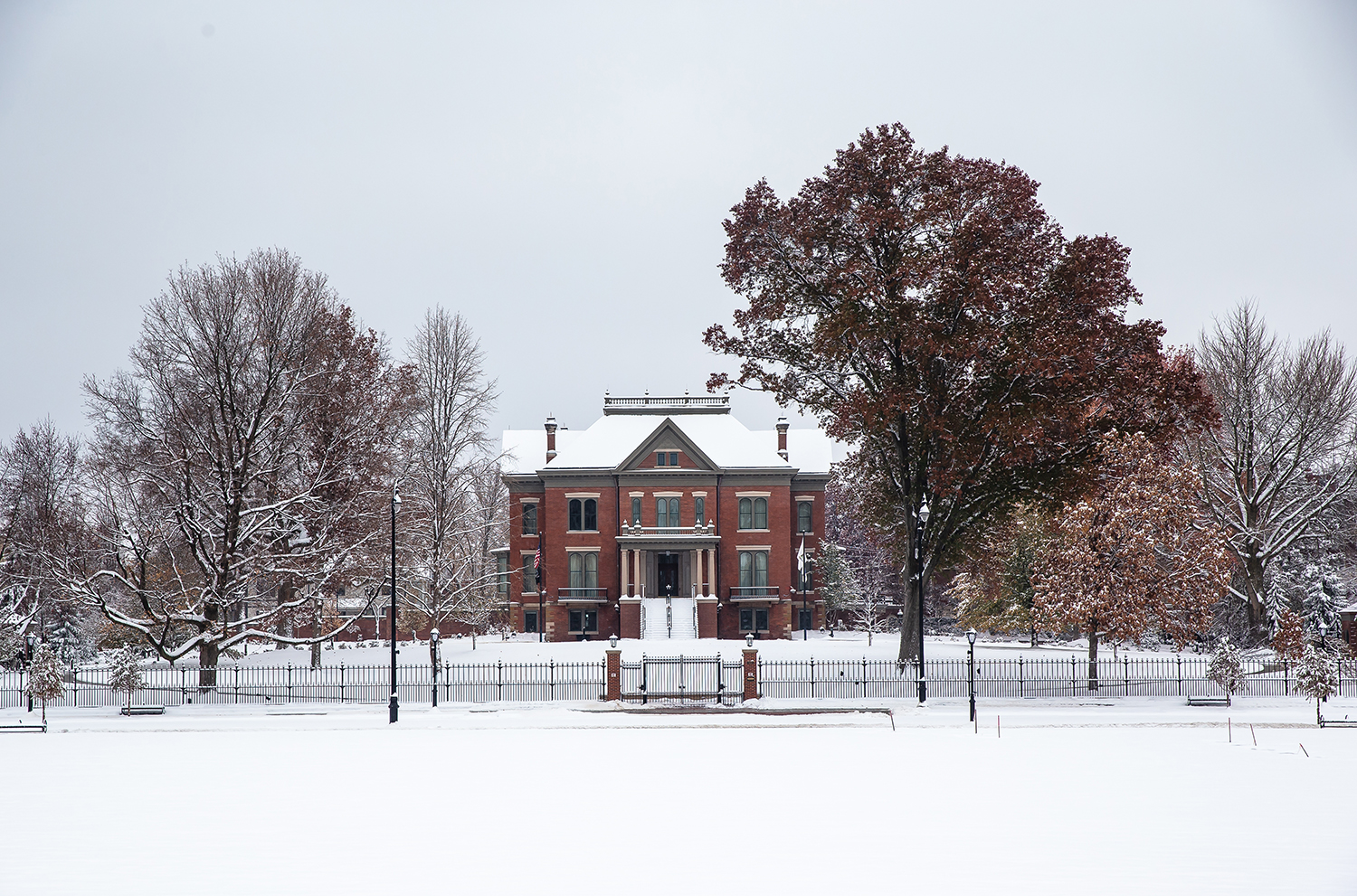 The Illinois Governor's Mansion is blanketed with snow with leaves still on the tree after a November snow storm dumped over five inches of snow overnight across the area, Thursday, Nov. 15, 2018, in Springfield, Ill. [Justin L. Fowler/The State Journal-Register]