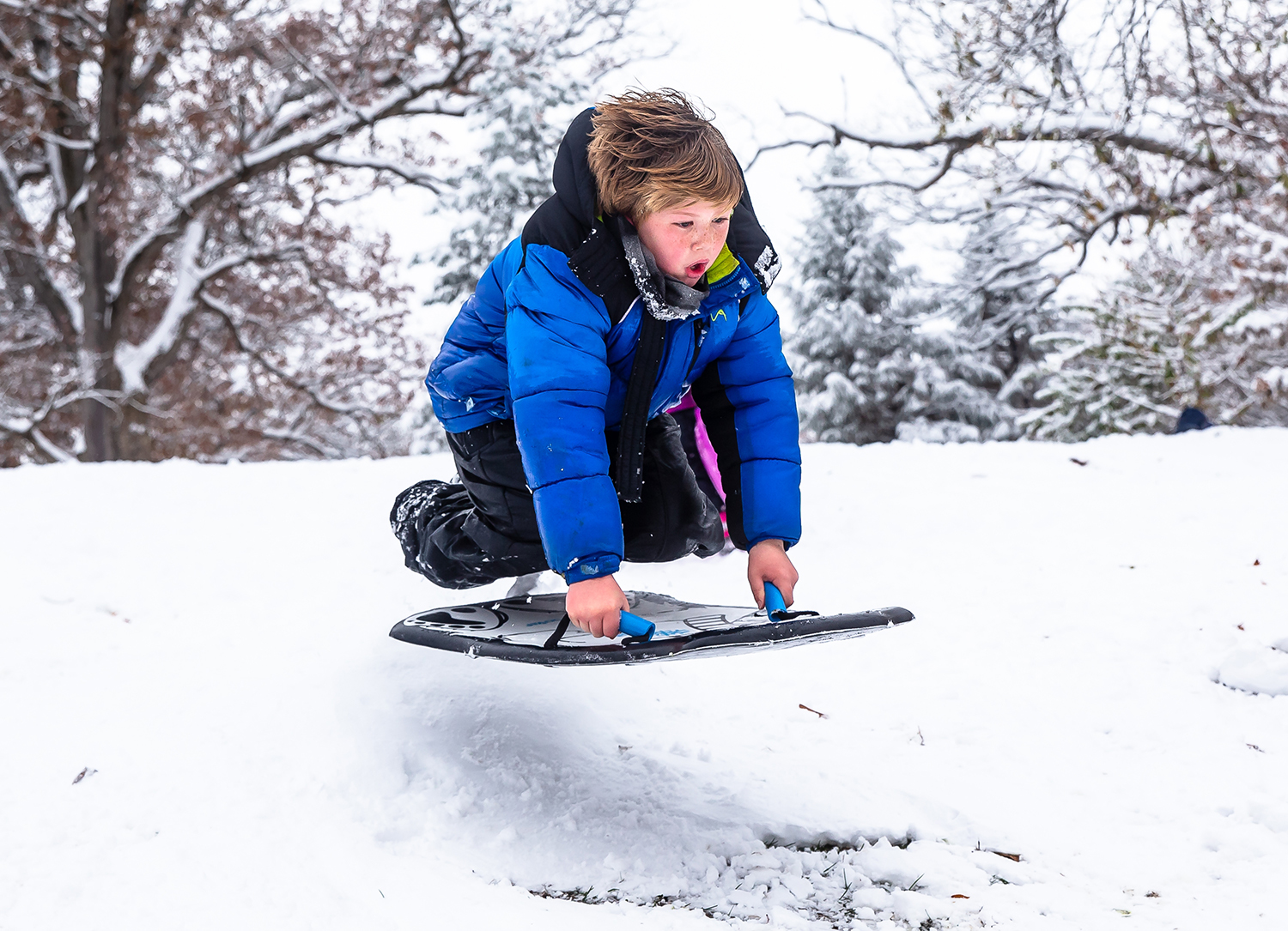"Felix Forney, 8, launches off a jump while sledding in Washington Park after a November snow storm dumped over five inches of snow across the area, Thursday, Nov. 15, 2018, in Springfield, Ill. ""You feel like you're just going to break something,"" said Forney who had made the jump too many times to count.  [Justin L. Fowler/The State Journal-Register]"