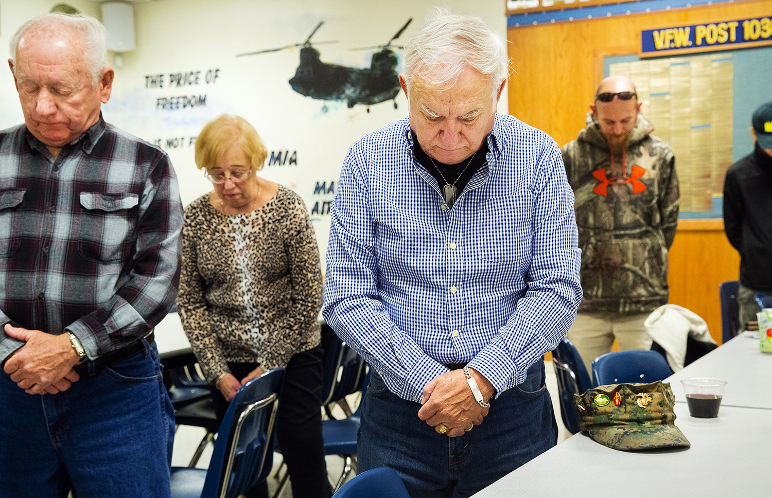 After observing a moment of silence in honor of military members serving overseas, Lee Williams, left, and William Demaree bow their heads in prayer before a Thanksgiving meal at the Northenders VFW Post 10302 Thursday, Nov. 22, 2018. The post opens the doors to anyone that would like to eat a Thanksgiving meal during the annual event. [Ted Schurter/The State Journal-Register]