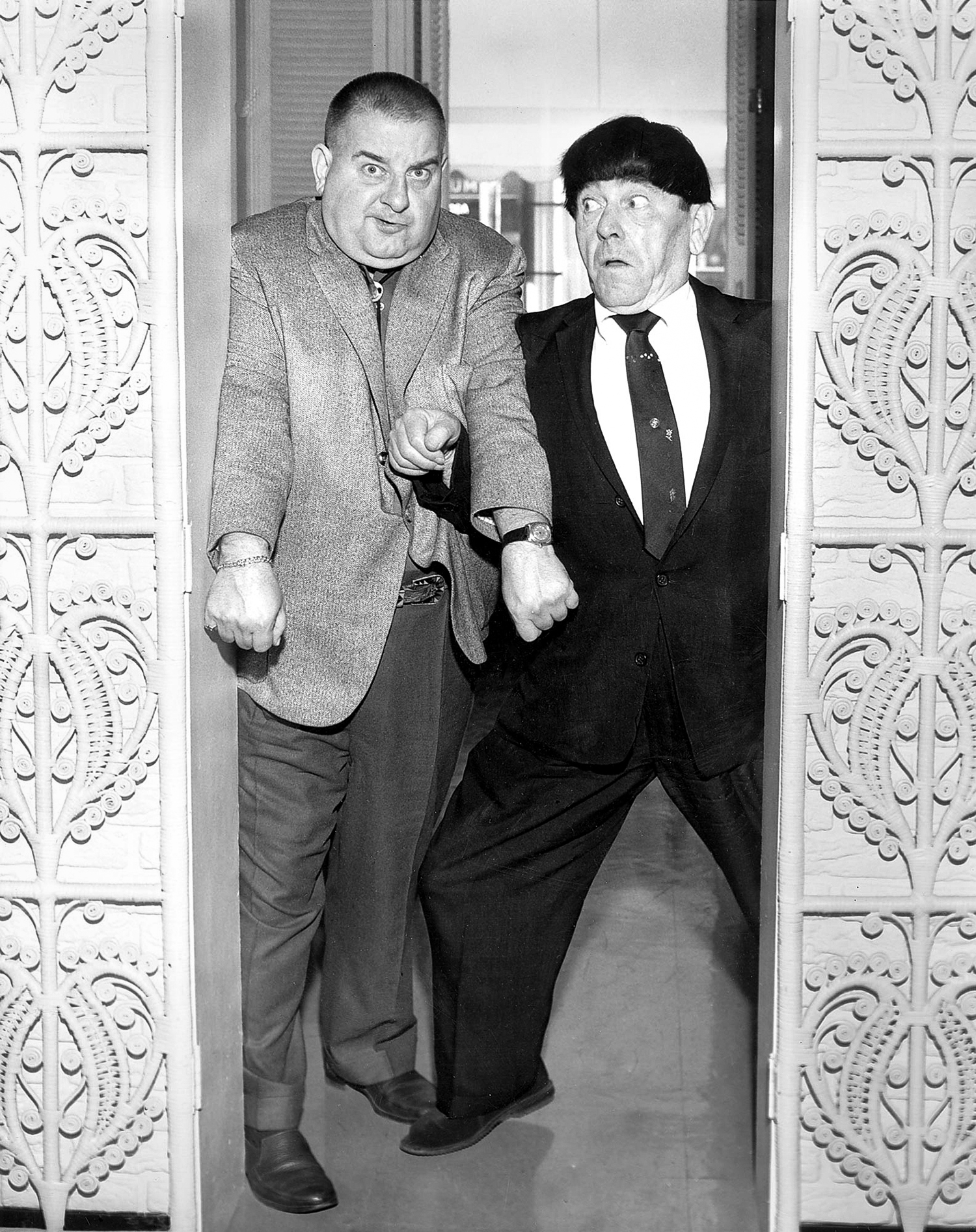 Two of the Three Stooges arrived a day early for their show at the Illinois State Fair in 1960. Curly Joe DeRita, left, and Moe Howard clown around in the Leland Hotel lobby for a Hagen's camera. The third Stooge, Larry Fine, arrived the next day. [Bill Hagen/The State Journal-Register]