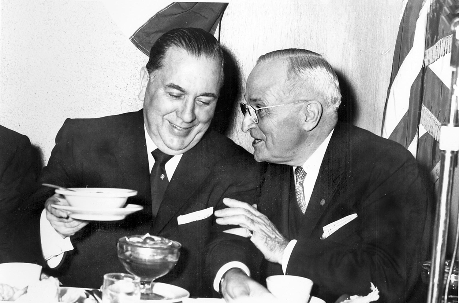 Chicago Mayor Richard Daley, left, passes the salad dressing to former President Harry S. Truman during a Democratic event at the Hotel St. Nicholas Oct. 8, 1959. [Bill Hagen/The State Journal-Register]