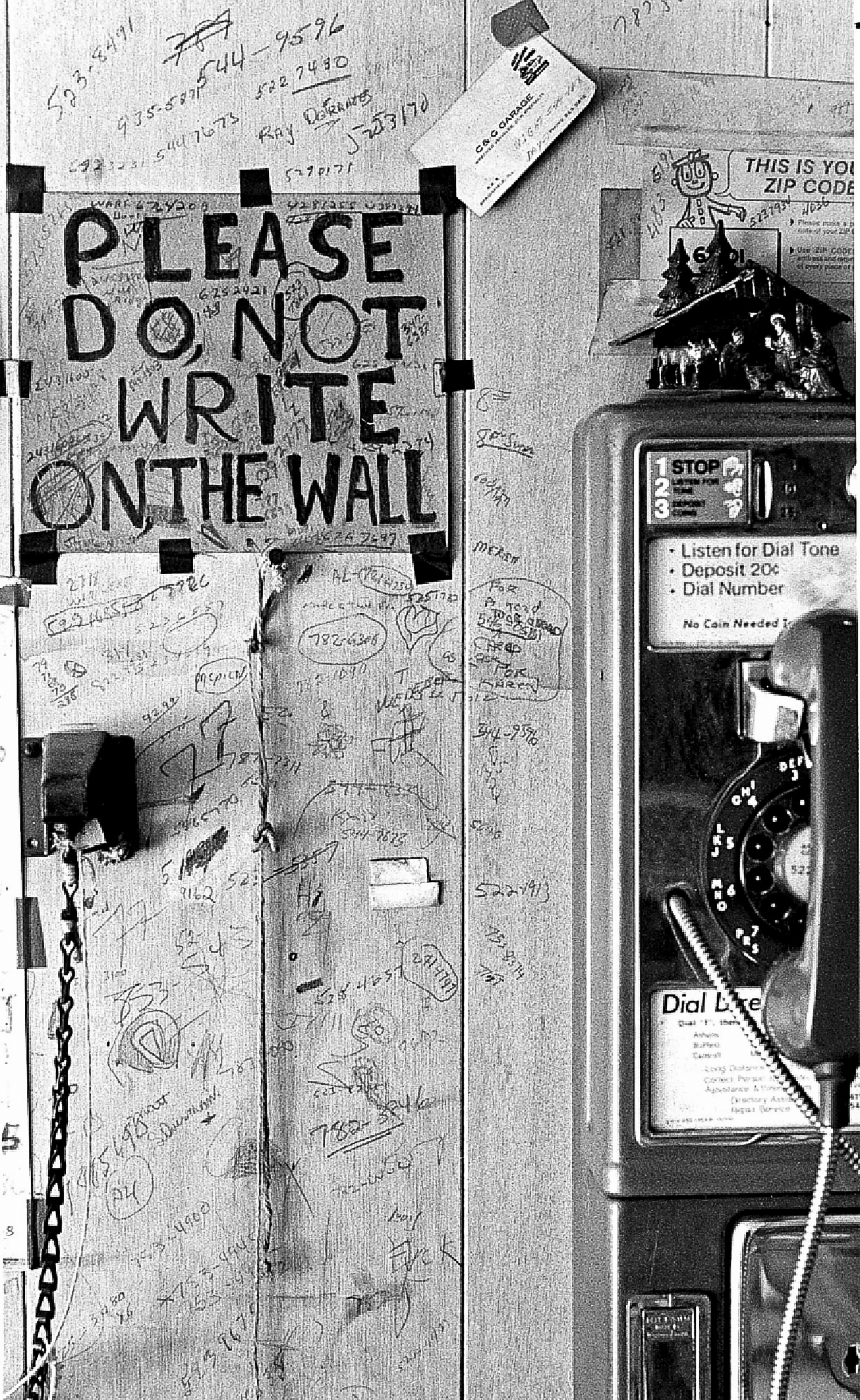 This photo of a sign on the wall of the Clover Leaf Pool Room at 206 N. Fifth St, ignored by visitors, was published Oct. 18, 1978. [Bill Hagen/The State Journal-Register]