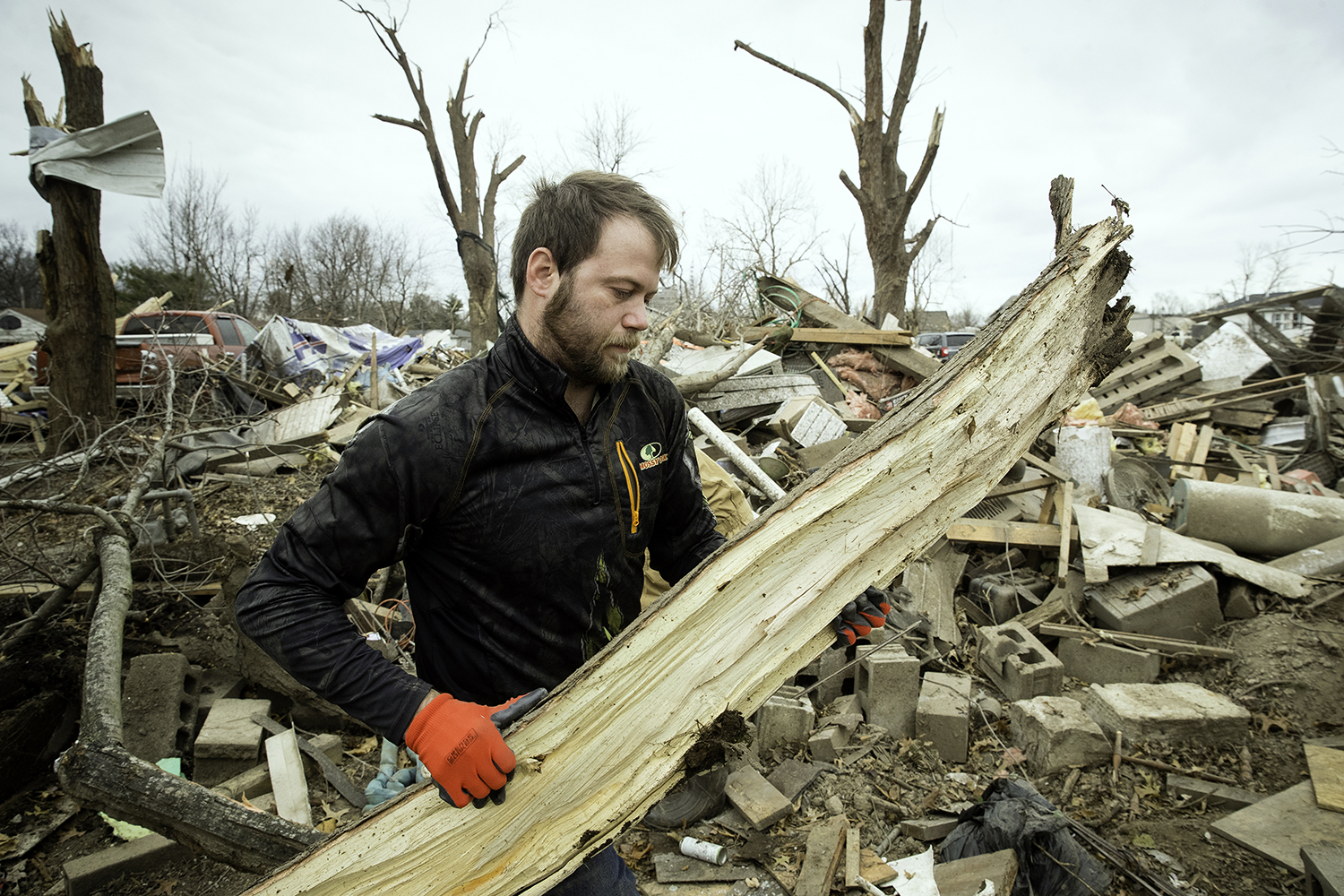 Steven Tirpak cleans debris from the remains of his two-story home in Taylorville Sunday, Dec. 2, 2018. Tirpak and his infant were not home when the storm struck. [Ted Schurter/The State Journal-Register]
