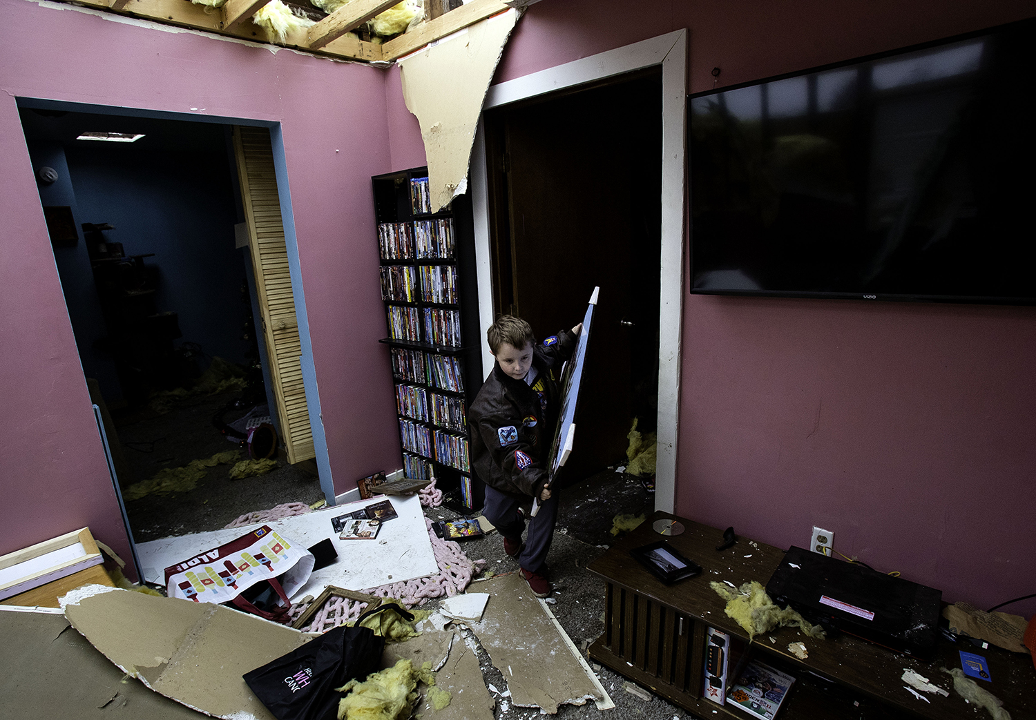 David Bowers retrieves items from the interior of his tornado damaged Taylorville home Sunday, Dec. 2, 2018. The roof of the home was completely torn off by the storm. [Ted Schurter/The State Journal-Register]