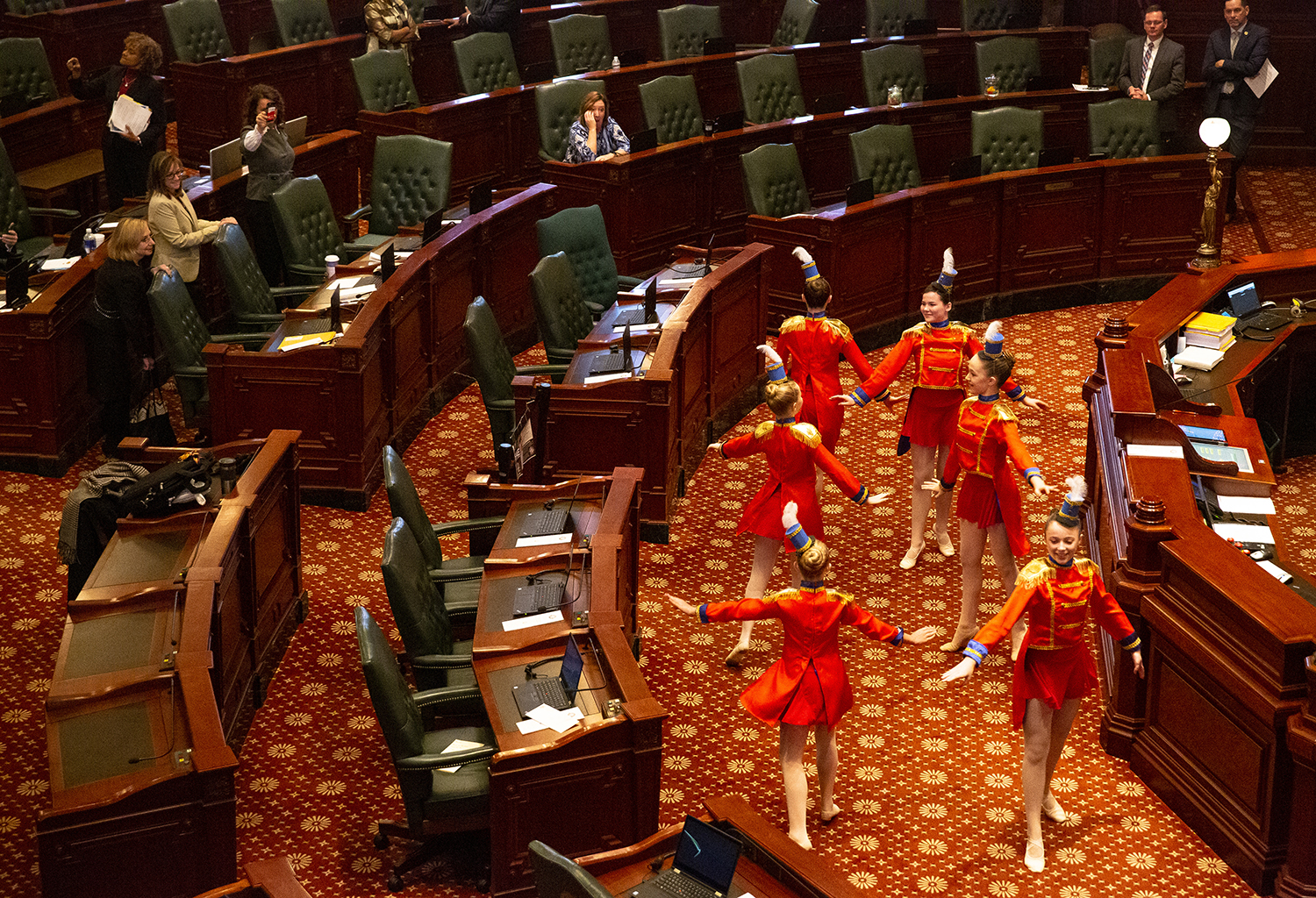 Members of the Springfield Youth Performance Group performed in the Illinois House Chamber before its veto session began Wednesday, Nov. 28, 2018 at the Capitol in Springfield, Ill. The presentation was part of an arts showcase sponsored by the House Museum, Arts & Cultural Enhancement Committee. The girls are, clockwise from lower left, Claire Sagins, Aislyn Grant, Ella Parkinson, Catherine Gardner, Mia Marcy and Ava Parkinson. [Rich Saal/The State Journal-Register]