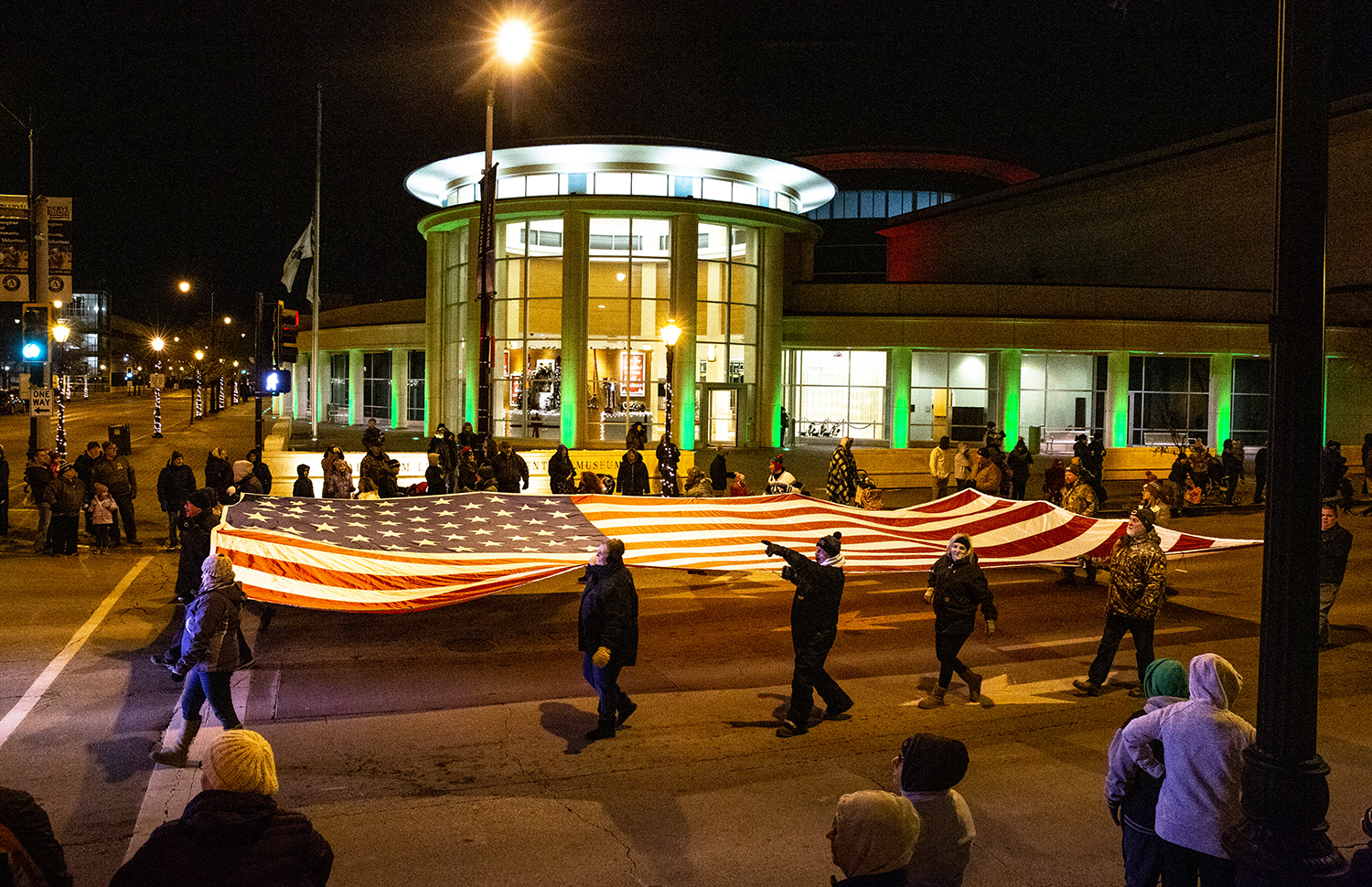 A flag presented by the Elks Lodge 158 passes the Abraham Lincoln Presidential Museum to kick off the Springfield Jaycees Holiday Lights Parade Saturday, Dec. 8, 2018 in Springfield, Ill. [Rich Saal/The State Journal-Register]