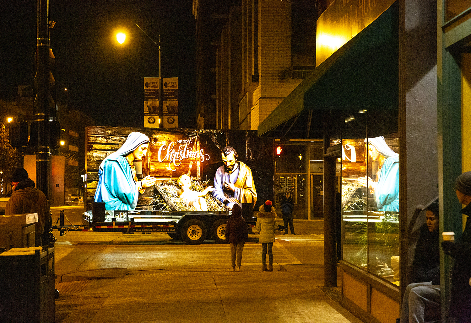A nativity scene co-sponsored by Butler Funeral Homes and Ace Sign Co., turns the corner at Sixth and Monroe streets during the Springfield Jaycees Holiday Lights Parade Saturday, Dec. 8, 2018 through downtown in Springfield, Ill. [Rich Saal/The State Journal-Register]