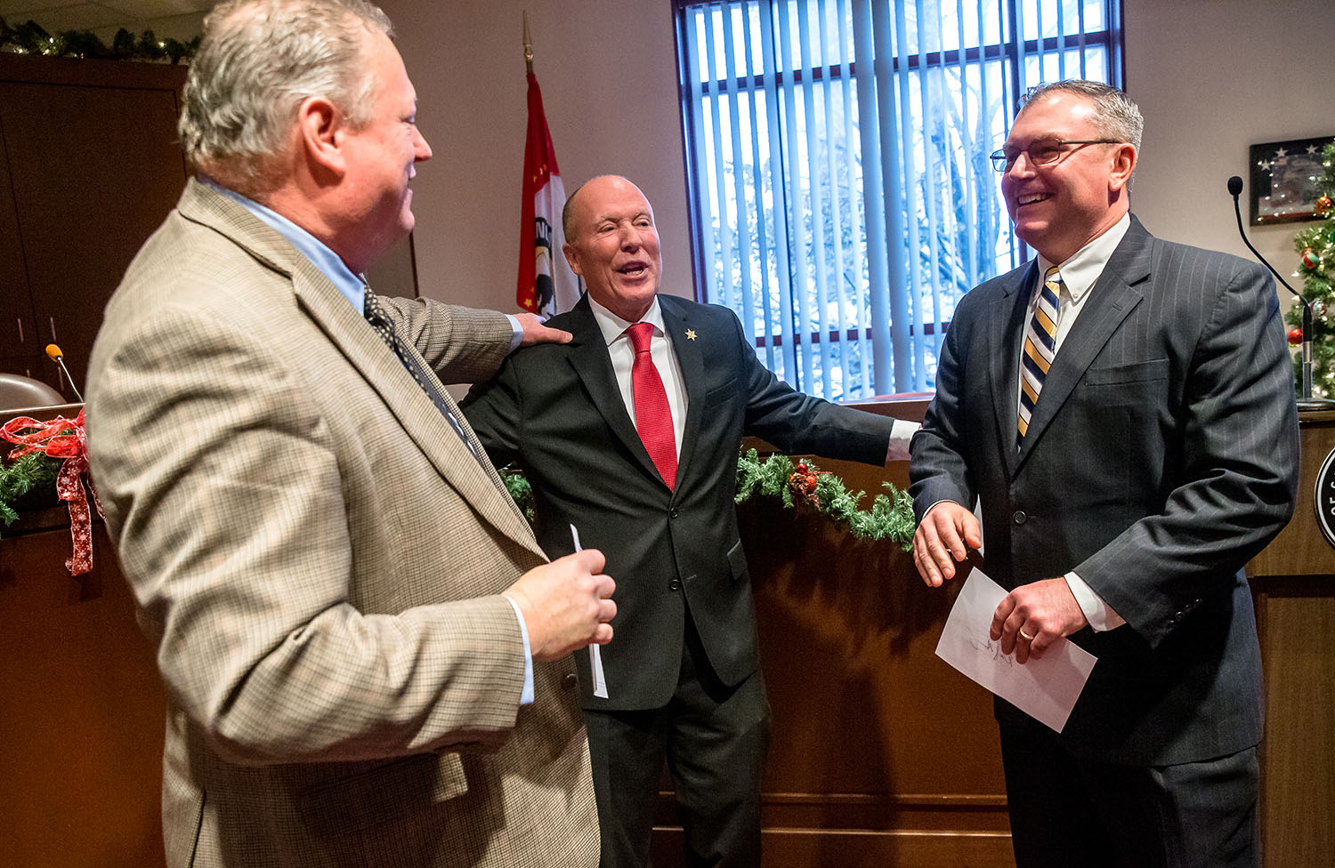 Sangamon County Sheriff Jack Campbell, center, is joined by Sangamon County Treasurer Joe Aiello, left, and Sangamon County Clerk Don Gray, right, after the three took the oath of office during a swearing-in ceremony in the Sangamon County Board Chambers at the Sangamon County Building, Monday, Dec. 3, 2018, in Springfield, Ill. [Justin L. Fowler/The State Journal-Register]