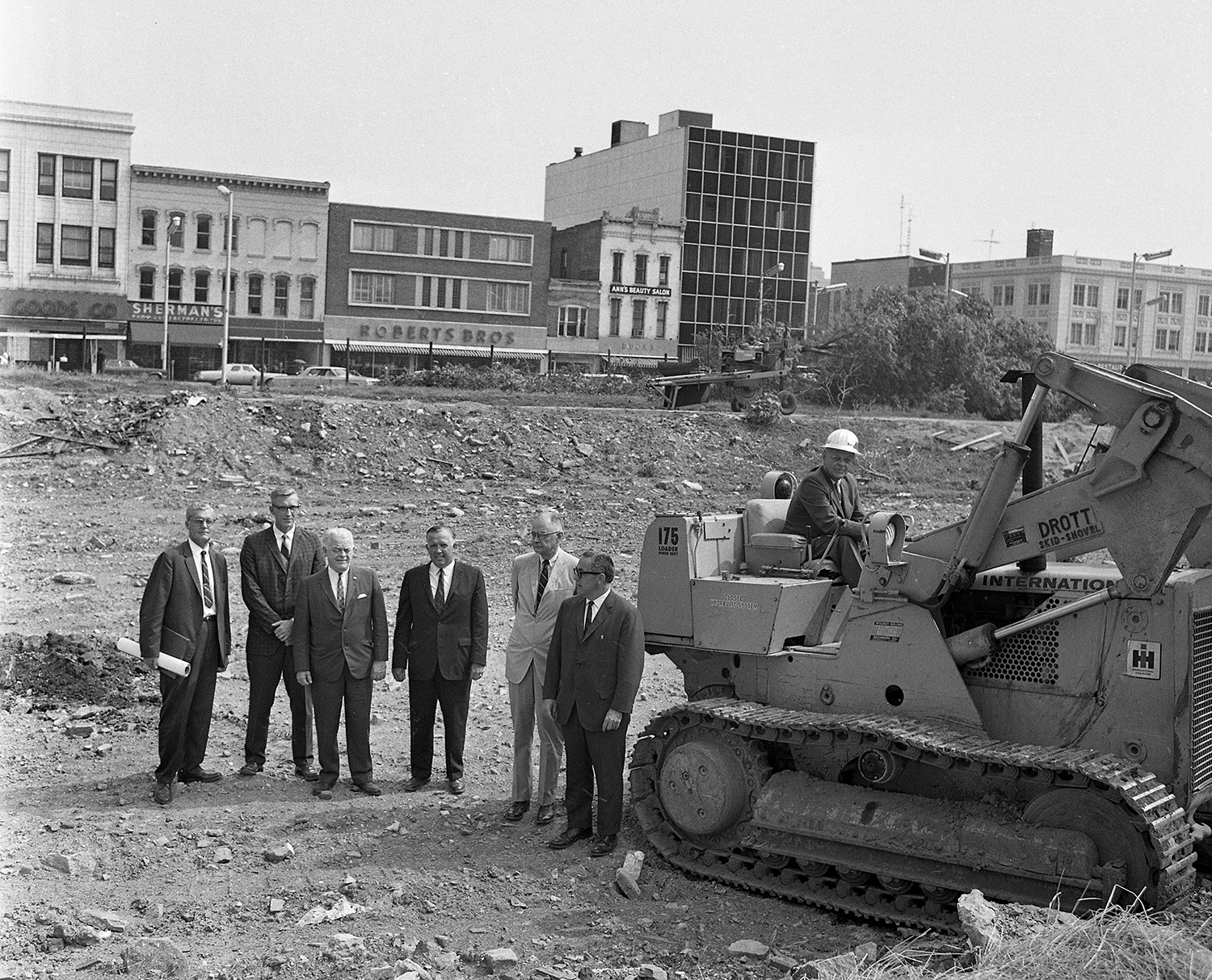 Russell Dunlap, left, project manager of the state architects office; A.P. Wisnowsky of Ferry and Henderson Architects; William E. Smith, assistant director of conservation; Richard Long of the Illinois Building Authority; and Clyde Walton, state historian. On the bulldozer is William Lodge, director of conservation, photographed July 1966 at the excavation site for the Old State Capitol. File/The State Journal-Register