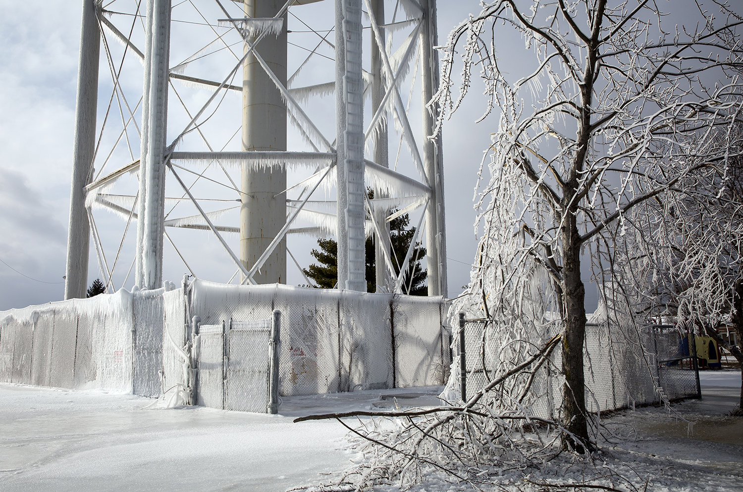 A faulty valve is blamed for allowing the water tower in Chatham to overflow, which left the structure, the ground and trees in the area coated with ice Wednesday, Jan. 3, 2018 at Jaycee Park in Chatham, Ill. [Rich Saal/The State Journal-Register]