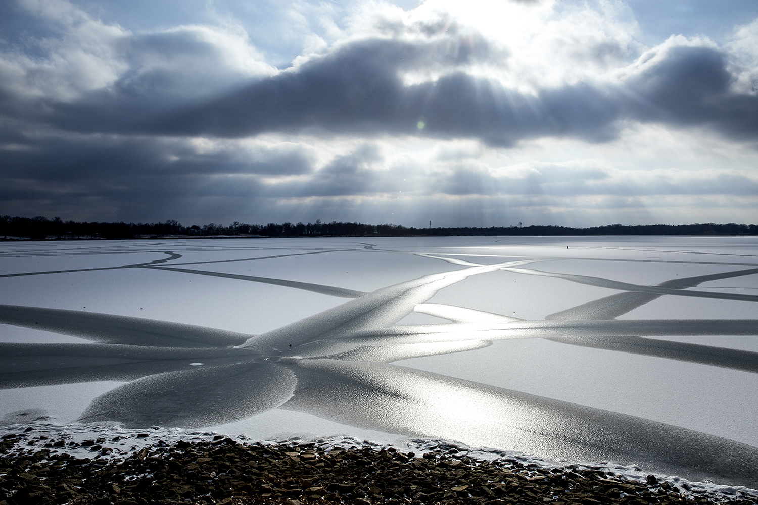 Patterns in the ice stretch across Lake Springfield toward the late afternoon sun in a view off East Lake Shore Drive Wednesday, Feb. 7, 2018. [Rich Saal/The State Journal-Register]