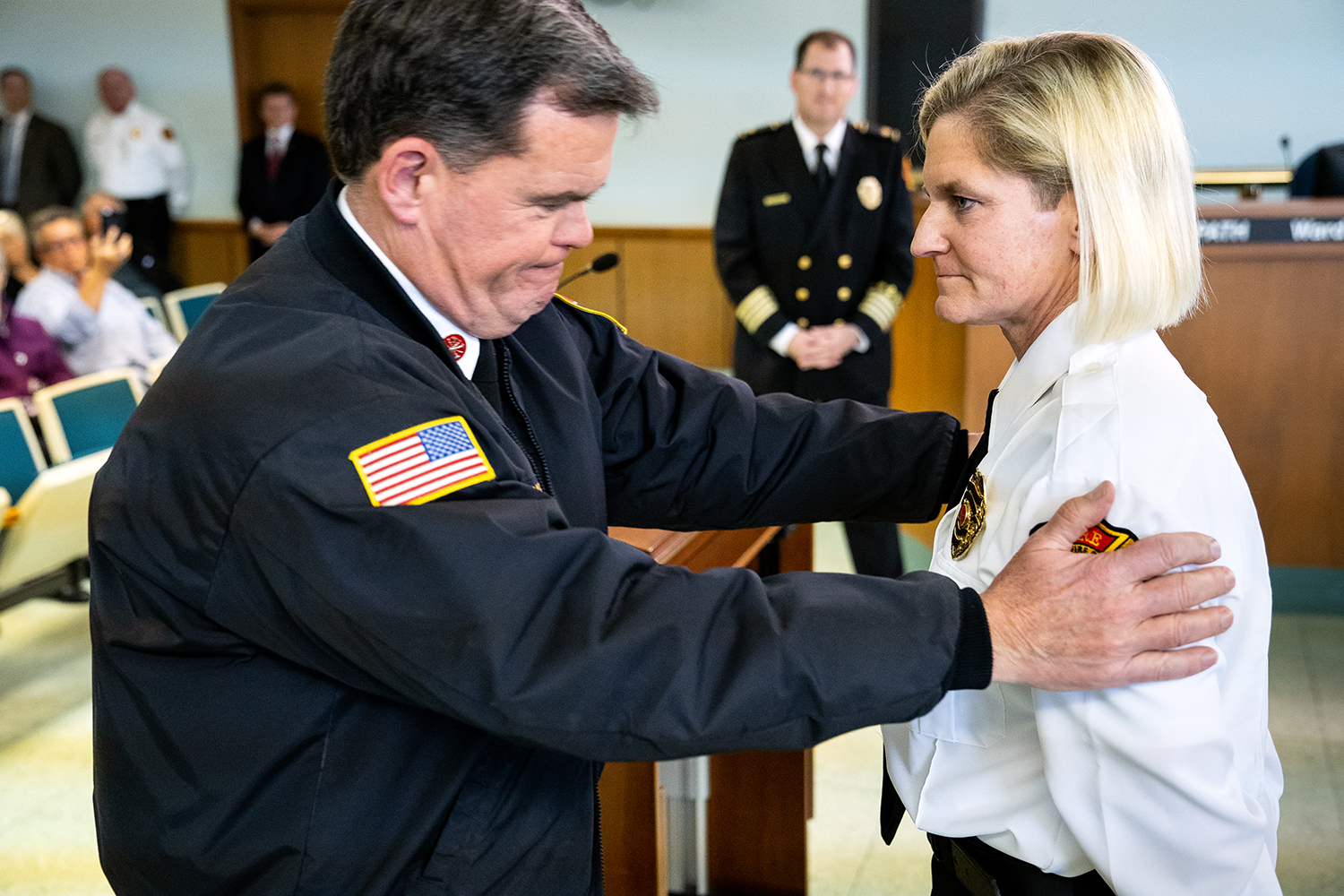 Springfield Fire Department Capt. Heather Moore was one of three department veterans promoted to division chief during a ceremony in the city council chambers Wednesday, April 18 2018 in Springfield, Ill. She's the department's first female to attain the rank. Patrick Kenny, a close friend of Moore's, pinned her badge. [Rich Saal/The State Journal-Register]