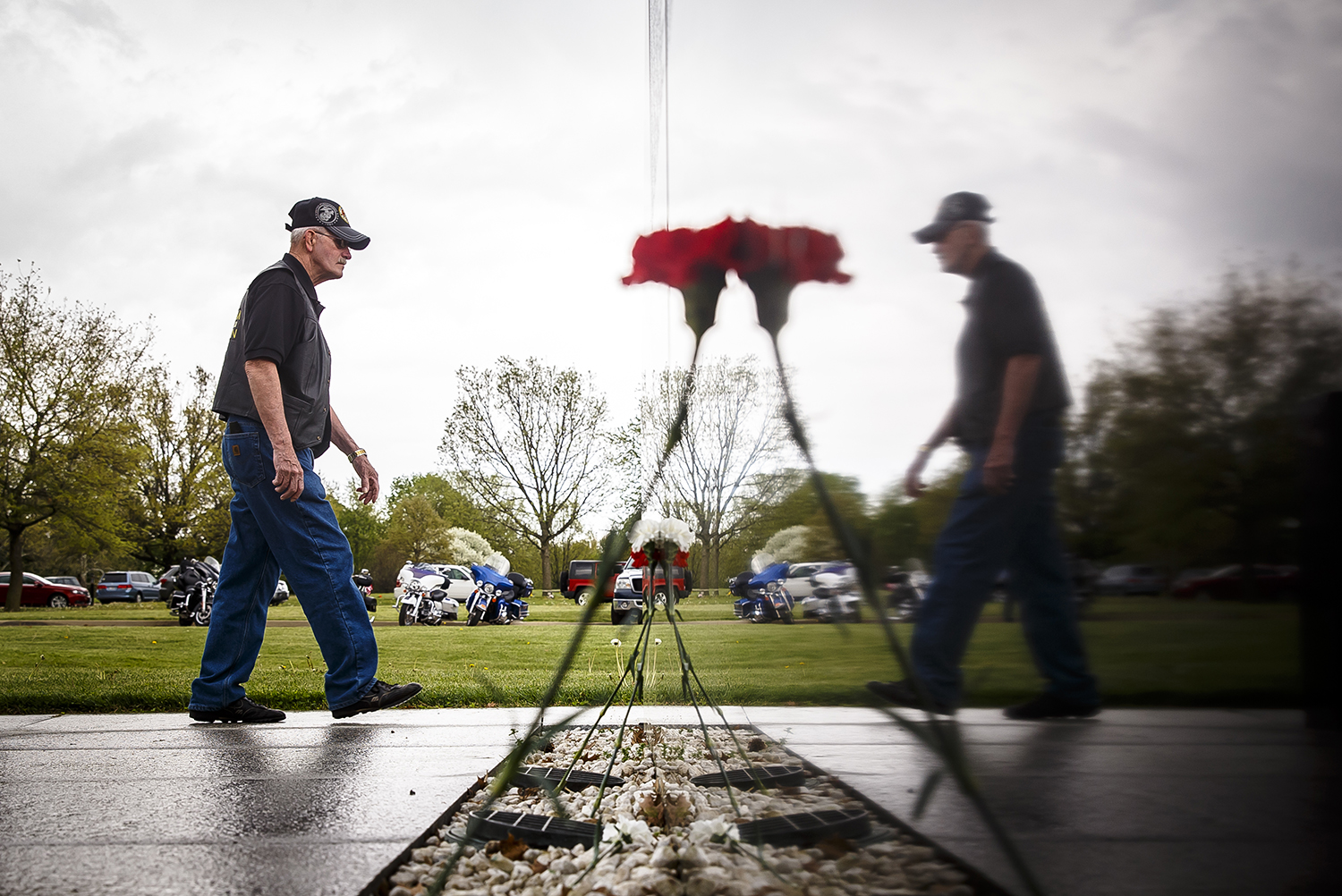 Tom Burcham, of Mattoon, Ill., a Vietnam Veteran with the Marine Corps, walks past one of the five granite walls, each representing a branch of the military and contain the names of the 2,938 Illinois servicemen who died in the Vietnam War, at the Illinois Vietnam Veterans Memorial during the 30th annual Illinois Vietnam Veterans Vigil in Oak Ridge Cemetery, Sunday, May 6, 2018, in Springfield, Ill. The 24-hour vigil is done by individuals from organizations from across the state and are done in one hour increments and broken up into 15 minute segments so as many people that want to can have the opportunity to walk the vigil. [Justin L. Fowler/The State Journal-Register]