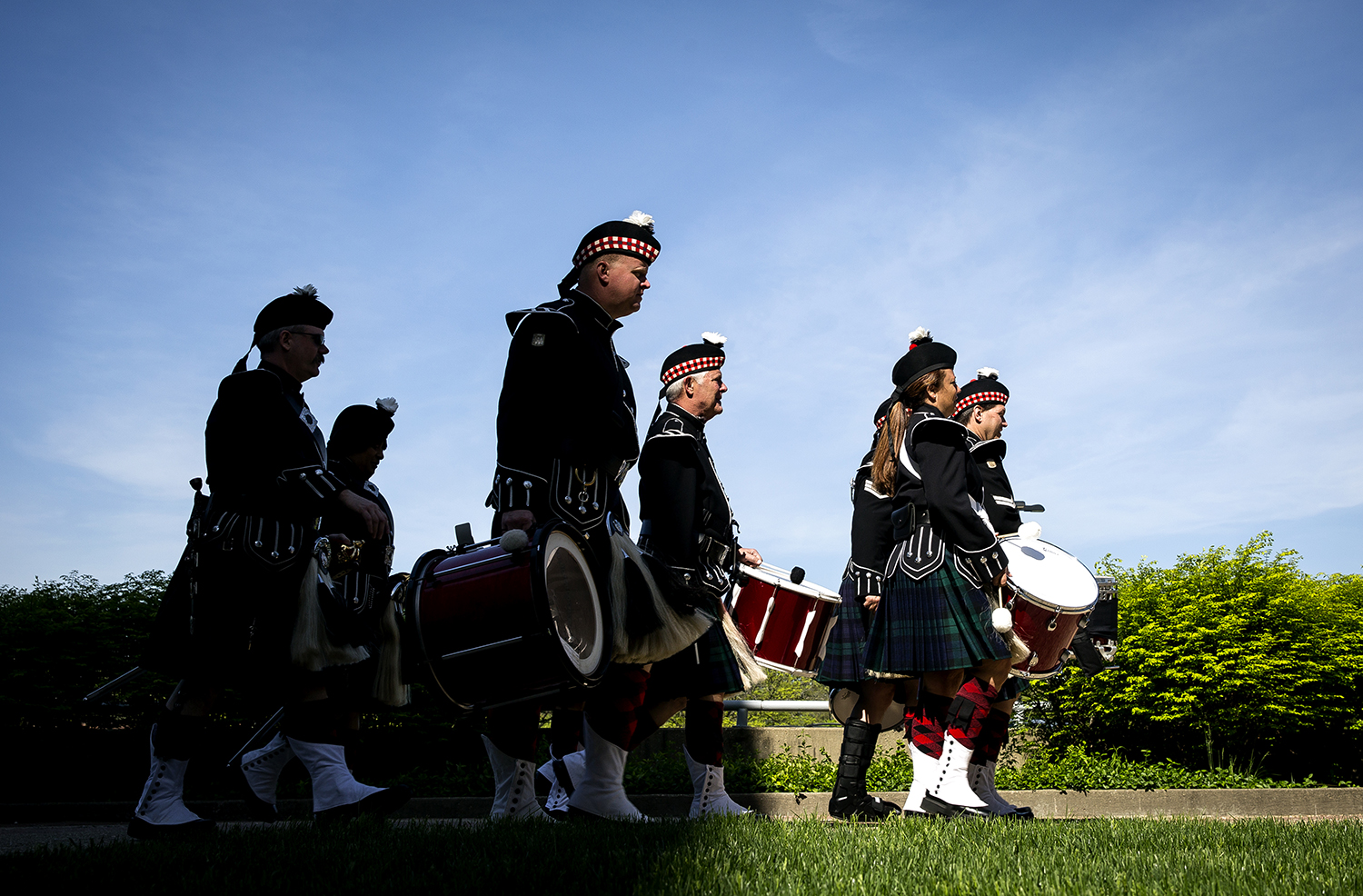 "Members of the Associated Firefighters of Illinois Honor Guard bagpipes walk toward the start of the 25th Annual Illinois Fallen Firefighter Memorial Tuesday, May 8, 2018 at the Firefighter's Memorial on the Capitol grounds in Springfield, Ill. Firefighters and their families from across the state gathered in Springfield to remember those who have given their lives in the line of duty, which this year include firefighters John ""Mike"" Cummins of the Homer Fire Protection District and Lawrence Matthews from the Village of Dolton Fire Department. Their families were presented with the Duty Death Gold Badge by state Fire Marshal Matt Perez. [Rich Saal/The State Journal-Register]"