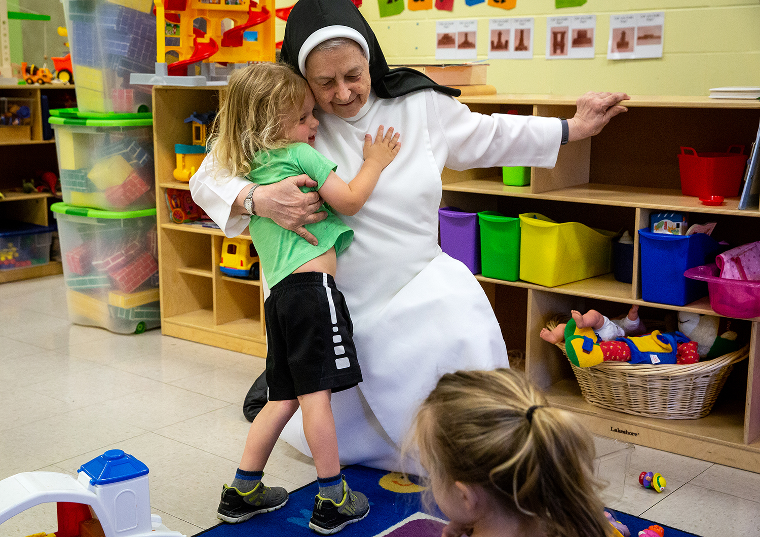Sr. Joan Sorge says it's the hugs she'll miss the most when she's no longer in the school every day. Sorge, who has been principal at St. Agnes School for 14 years and a Catholic educator for 40 years, is retiring and taking a new assignment with her order, the Springfield Dominicans. She spent time with pre-schoolers on their last day Thursday, May 17, 2018 at St. Agnes School in Springfield, Ill. [Rich Saal/The State Journal-Register]